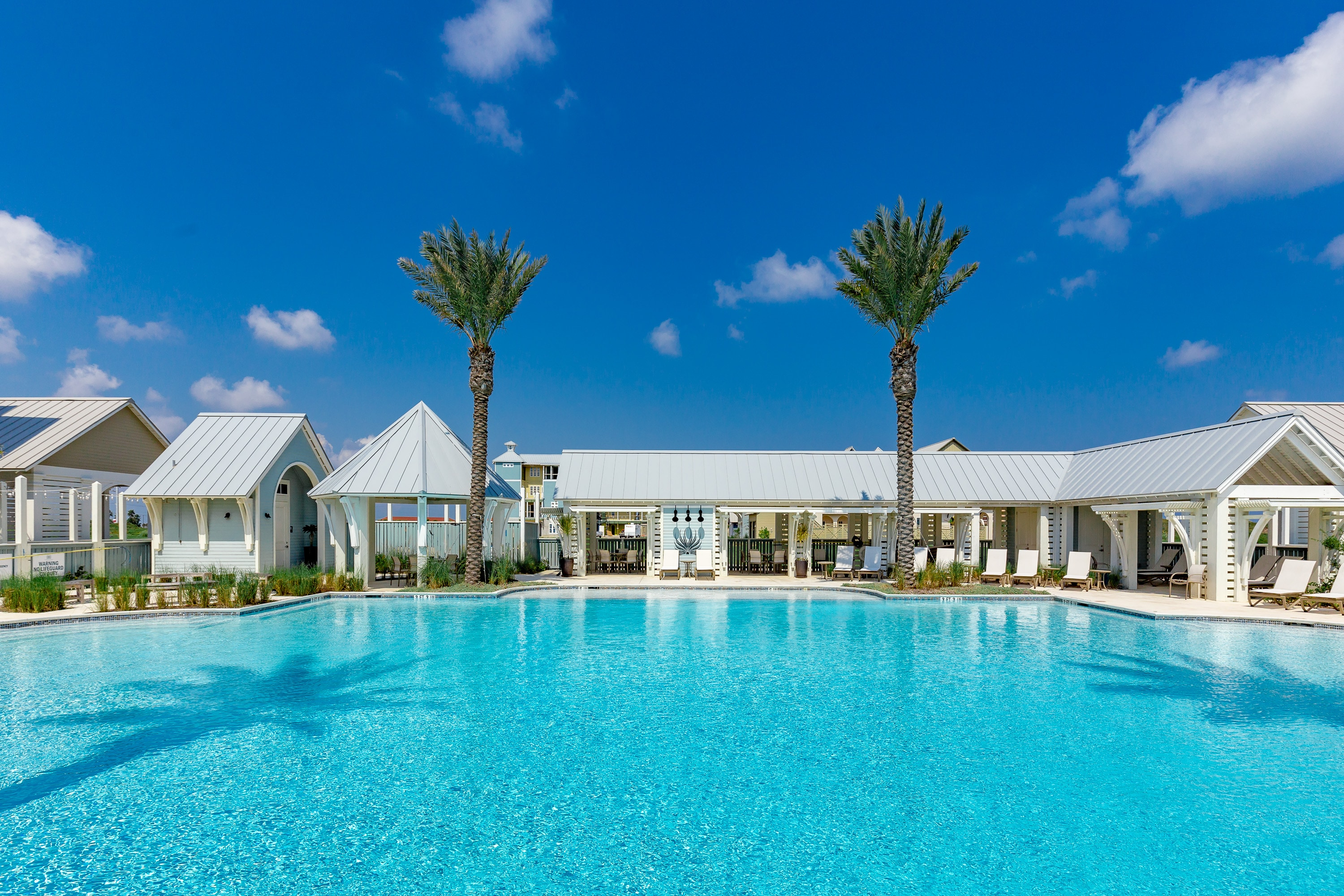 Luxuriate in the resort-style pool surrounded by cabanas.