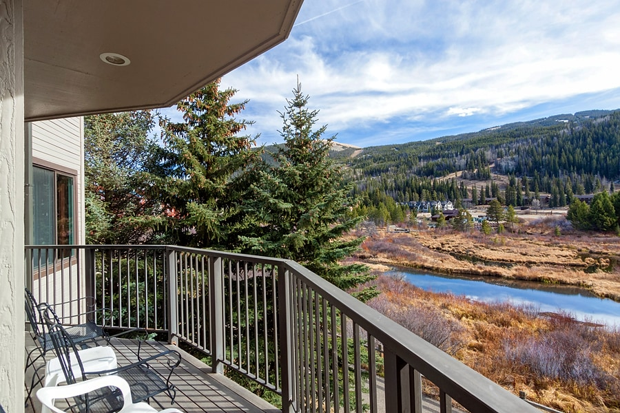 Enjoy the incredible view from deck w/chairs & grill