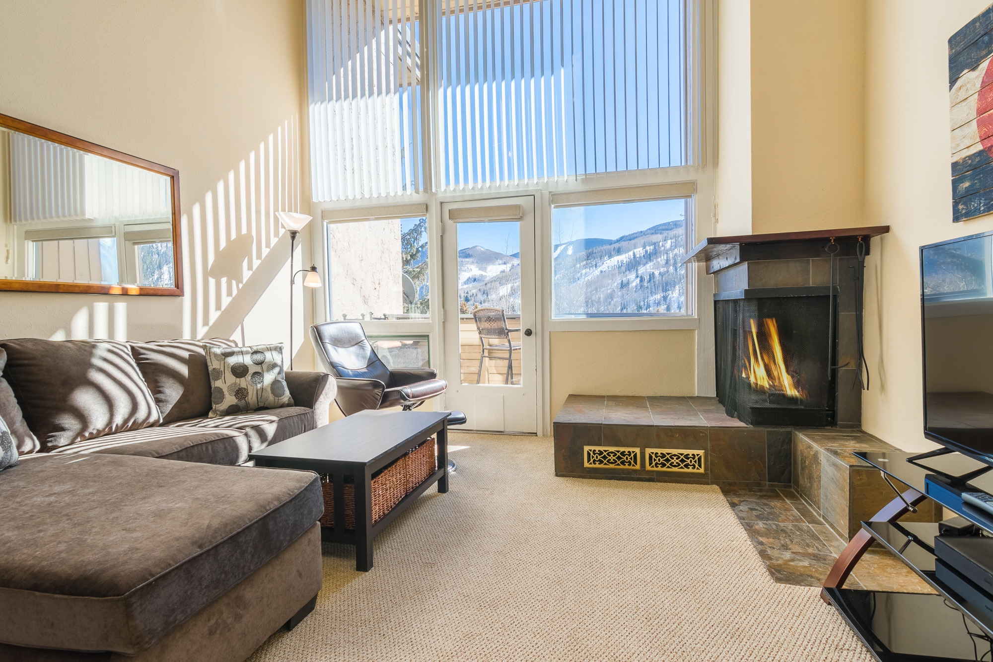 "The living room is also outfitted with a leather arm chair, 44"" flat-screen TV and wood-burning fireplace for those cold winter nights"