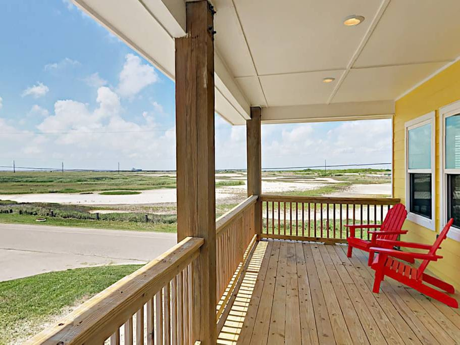 Relax on the front deck's Adirondack chairs overlooking the neighborhood