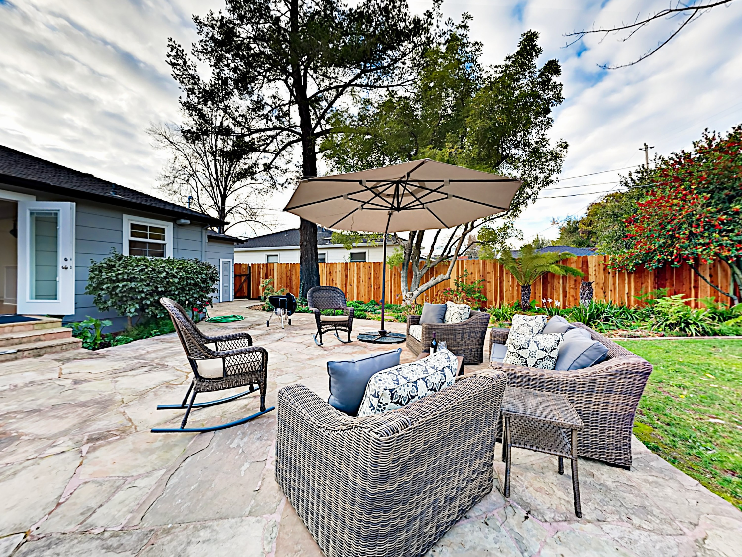 Soak up the sun on a sprawling patio in your fenced backyard.