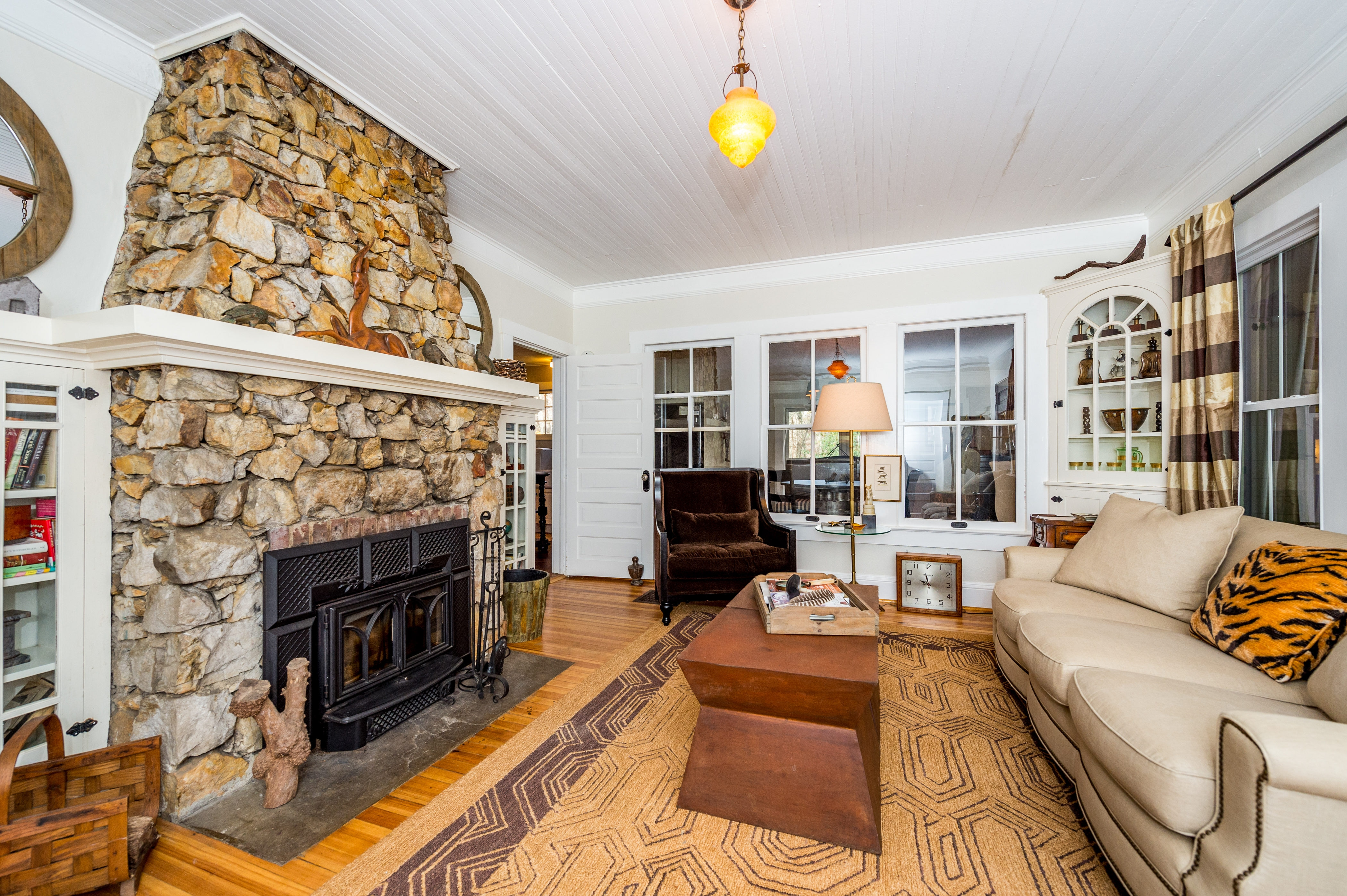Stone fireplace in the main home's living room, plus comfy seating for 4.