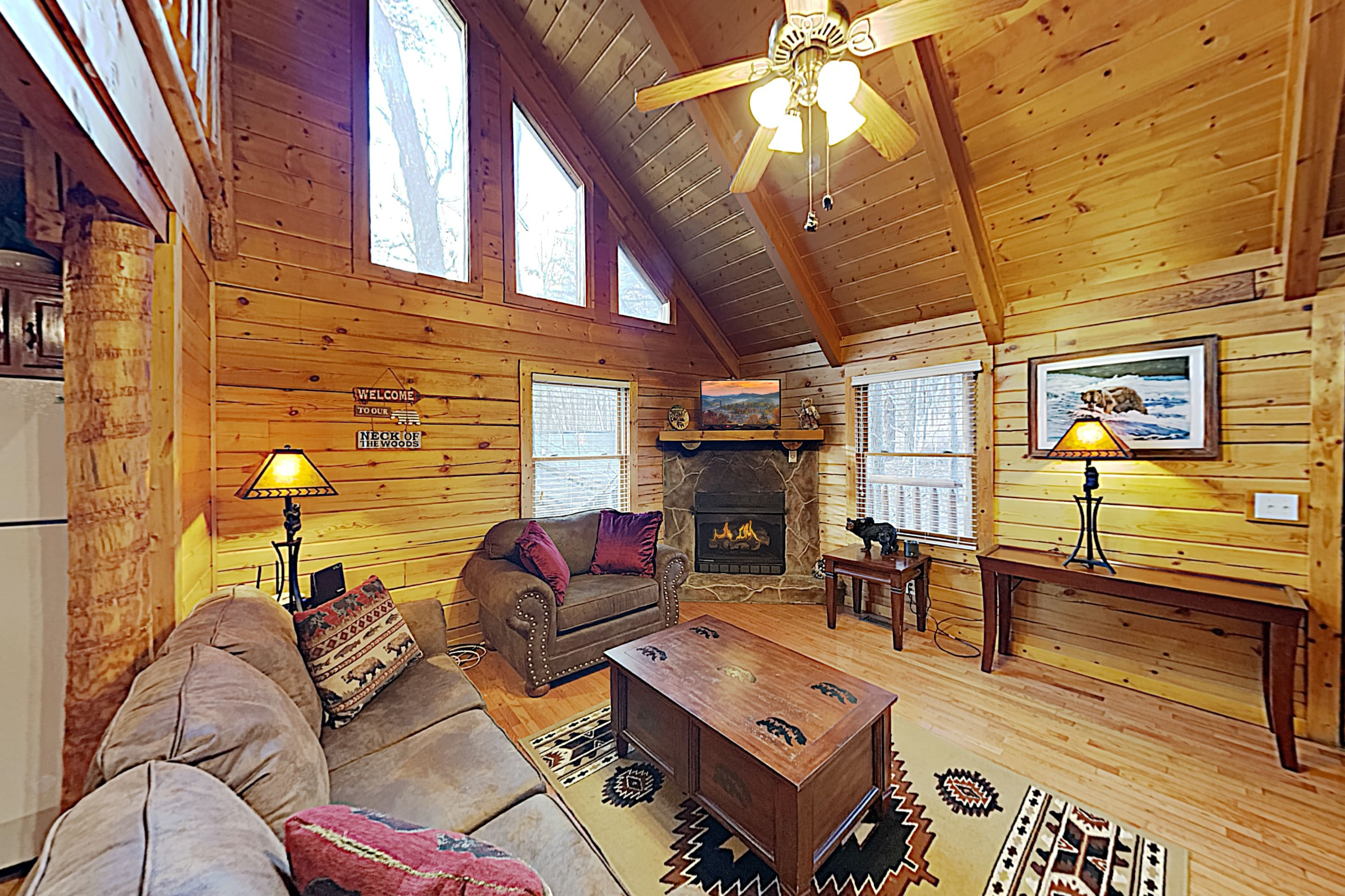 Welcome to Sevierville! Relax in style in the warm-hued living room, outfitted with a flat screen TV and fireplace.