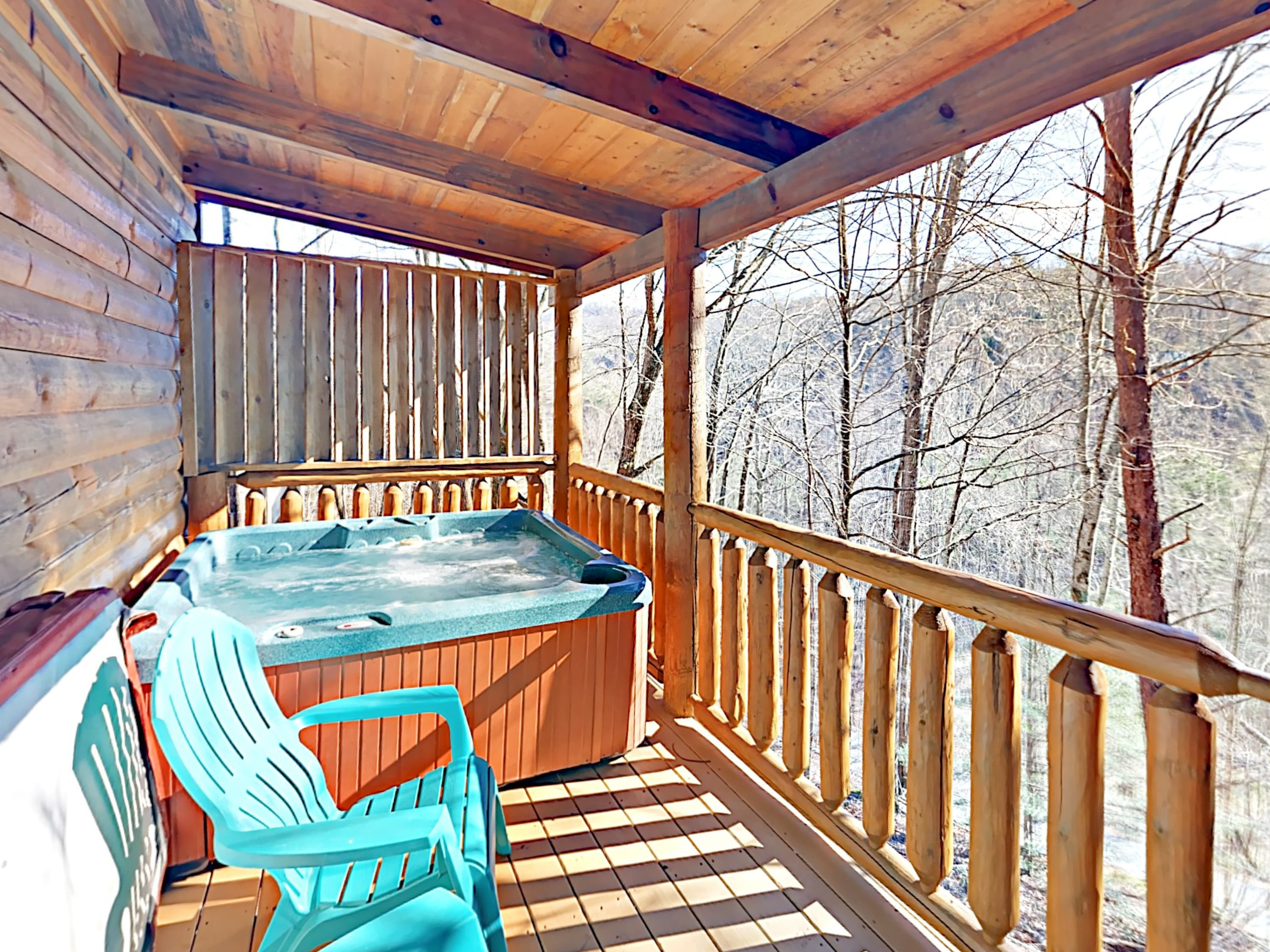 Slip into the bubbling hot tub for a relaxing soak with a view on the covered deck.
