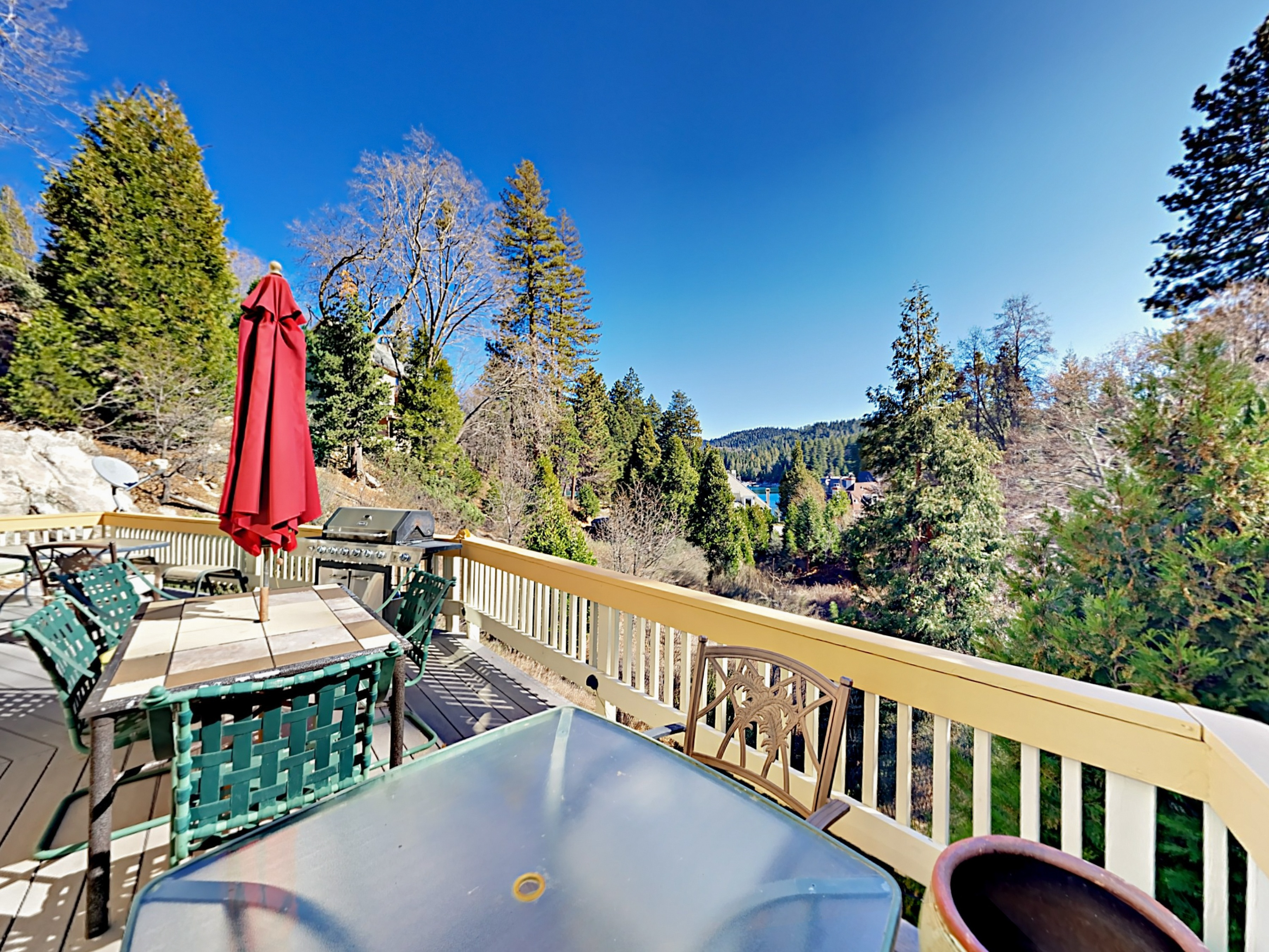Welcome to Lake Arrowhead! Upper deck with 3 patio tables, BBQ, and lake views. This property is maintained and managed by TurnKey Vacation Rentals.