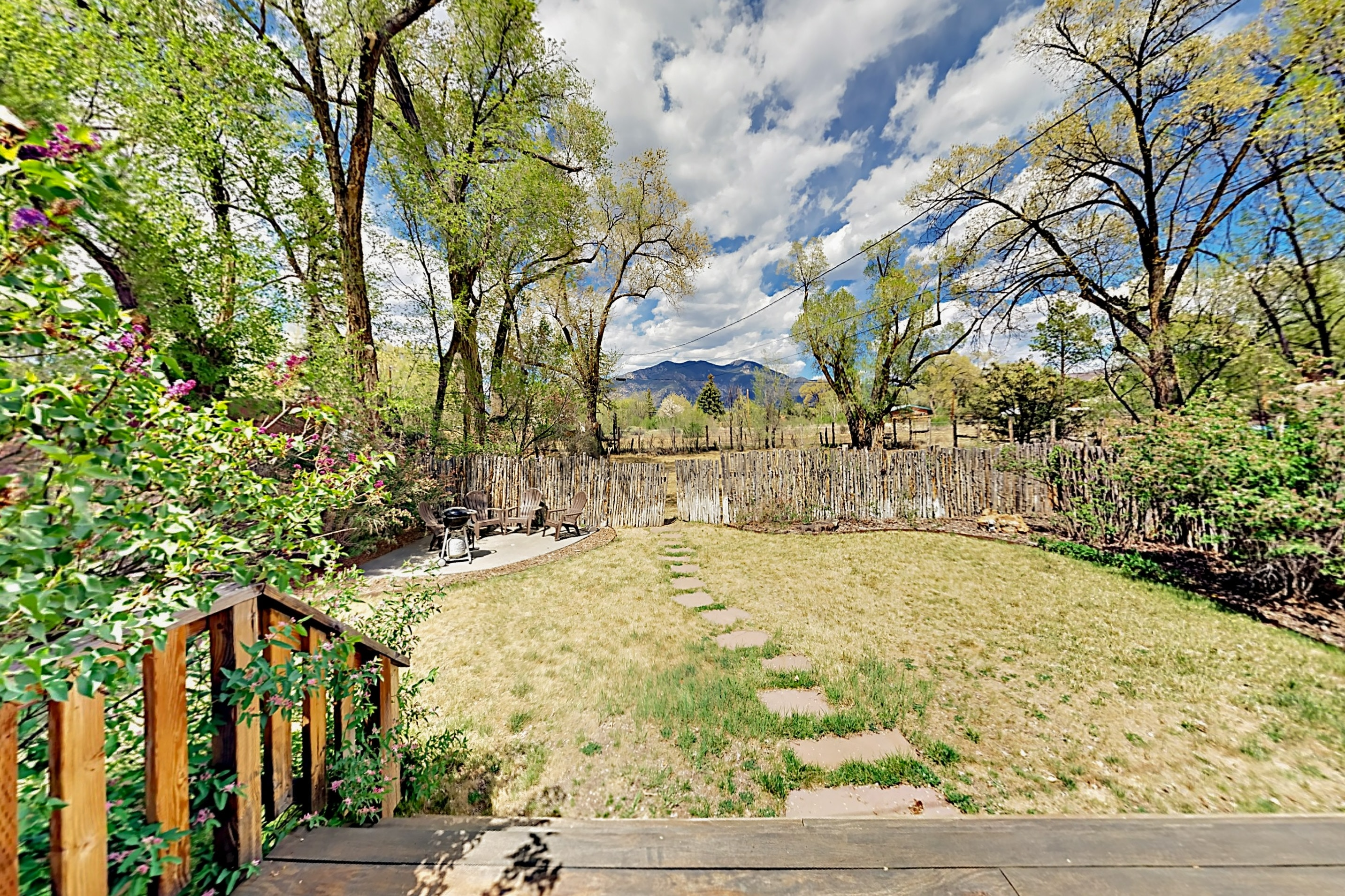 Soak up views of Taos Mountain from the back deck.