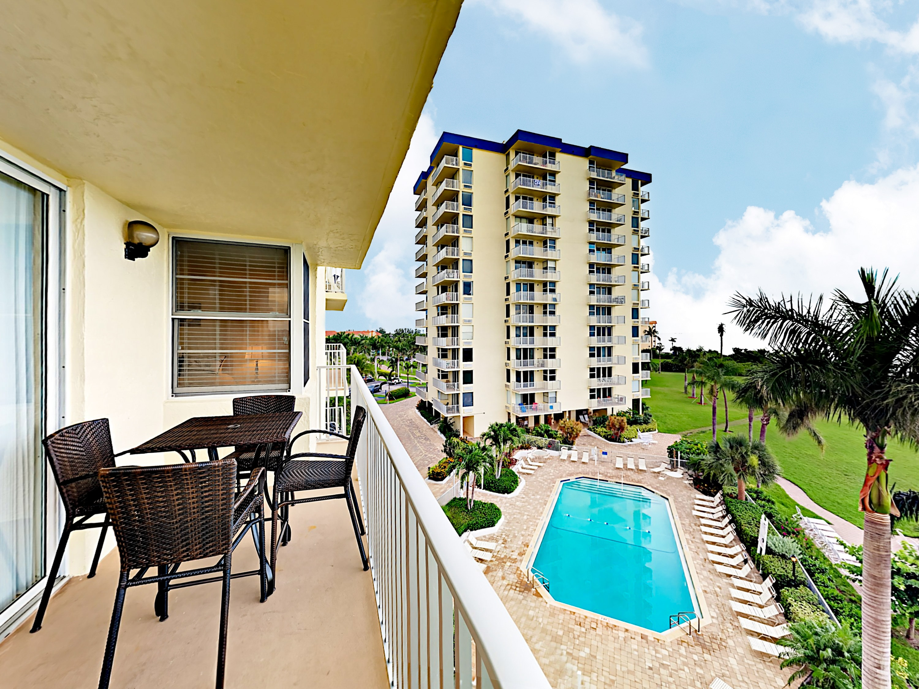 Welcome to Fort Myers Beach! Breathe the fresh coastal air on your 4th-floor balcony overlooking the pool.