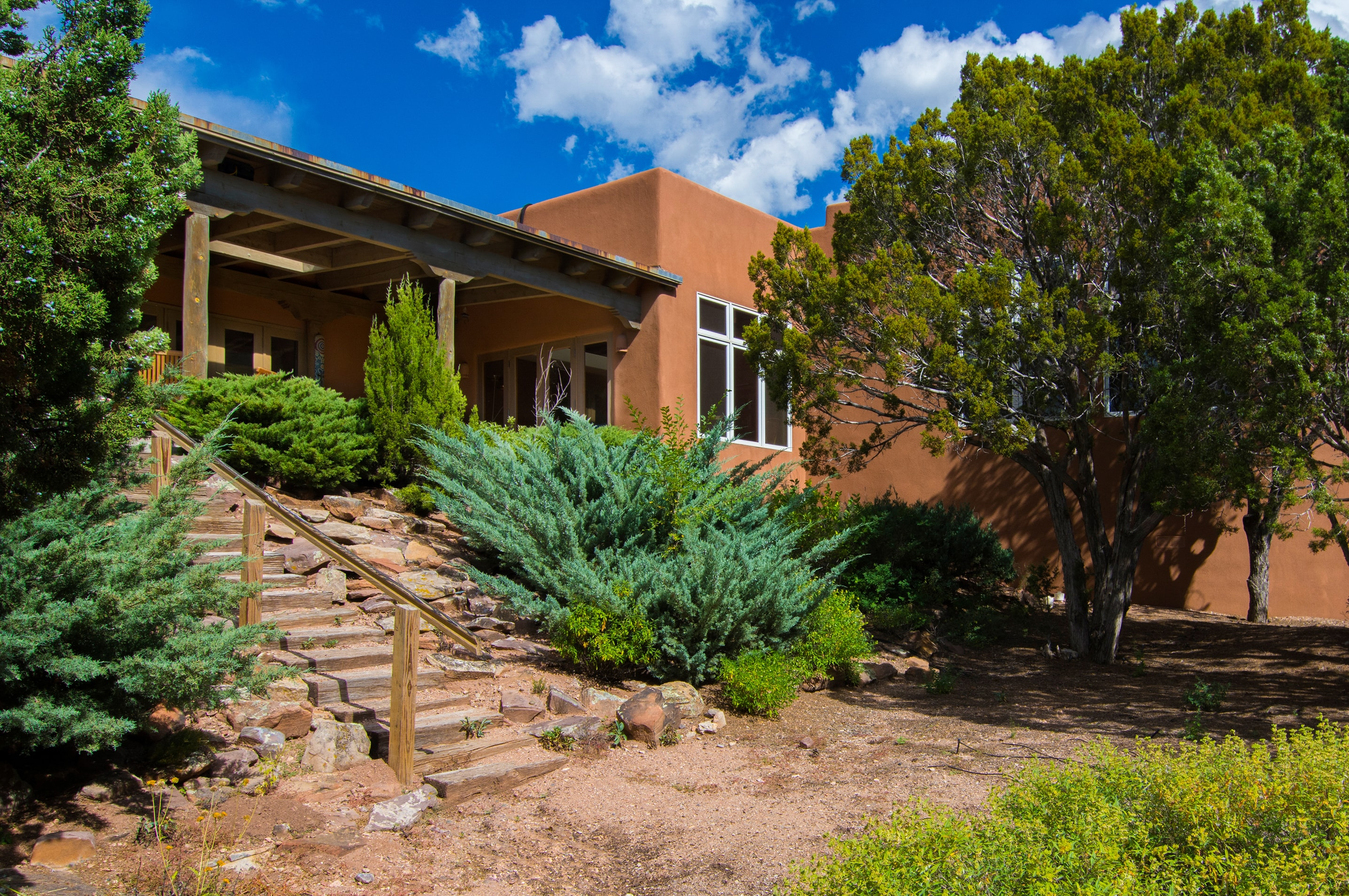 This Santa Fe manor sits on a 1-acre property approximately 1 mile from the Plaza.