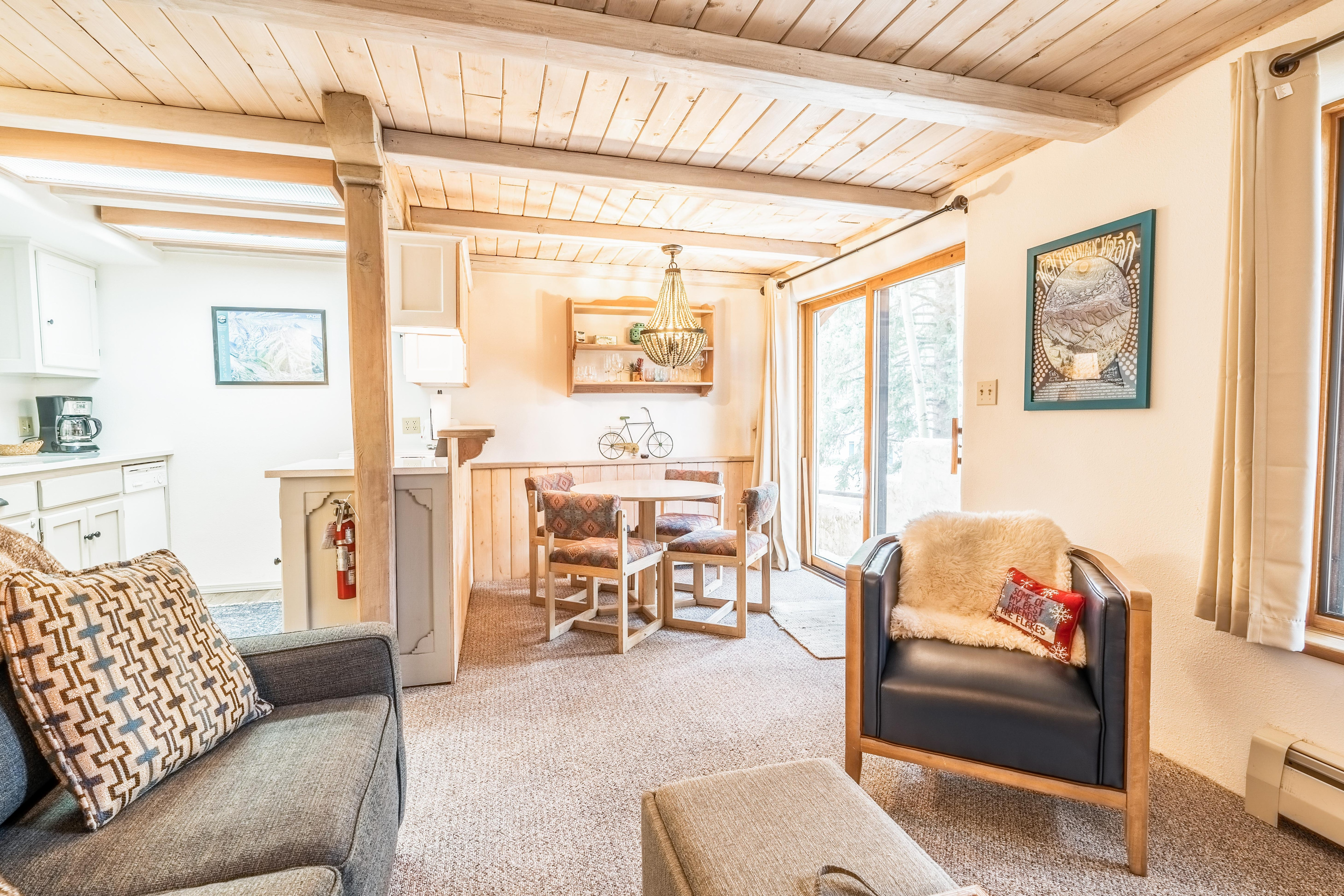 Welcome to Taos Ski Valley! Your rental is professionally managed by TurnKey Vacation Rentals. A leather armchair and comfy full-size sleeper sofa furnish the inviting living room.