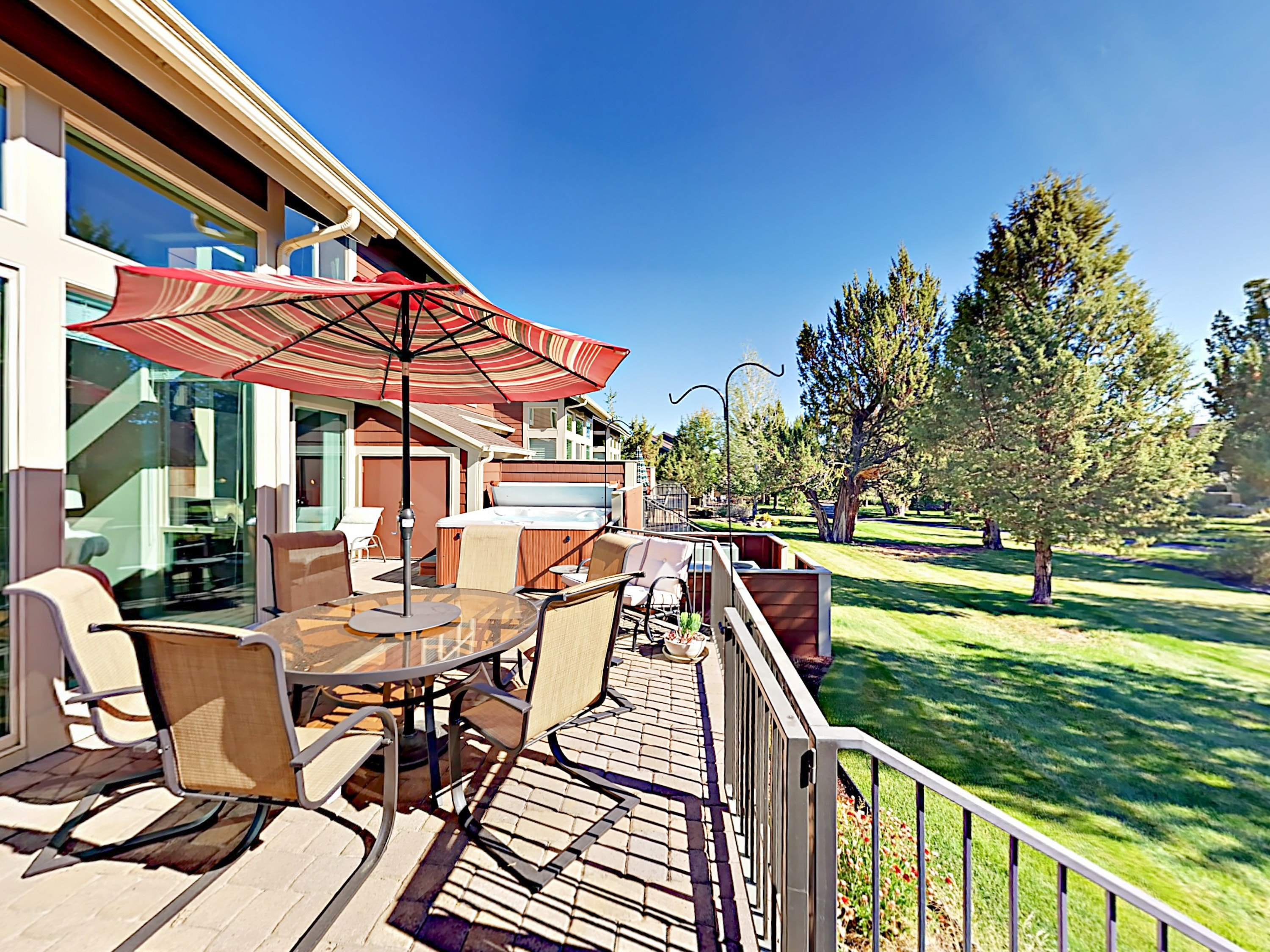 The expansive private deck overlooks lush lawns at the creek at Eagle Crest Resort.