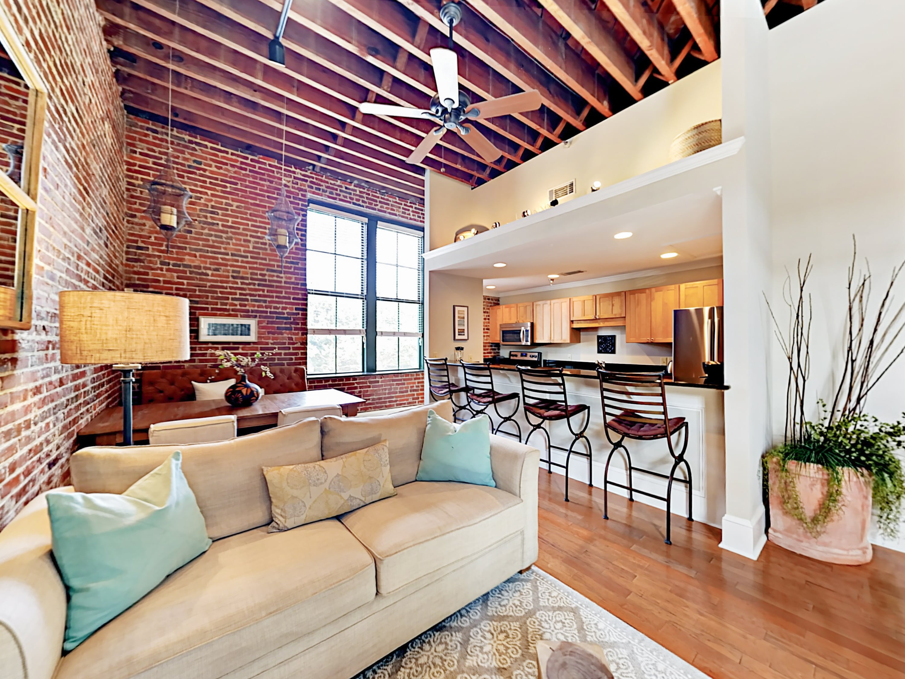 Originally built in 1860, this elegantly restored condo features tall ceilings with exposed beams, original brick walls, and hardwood floors.