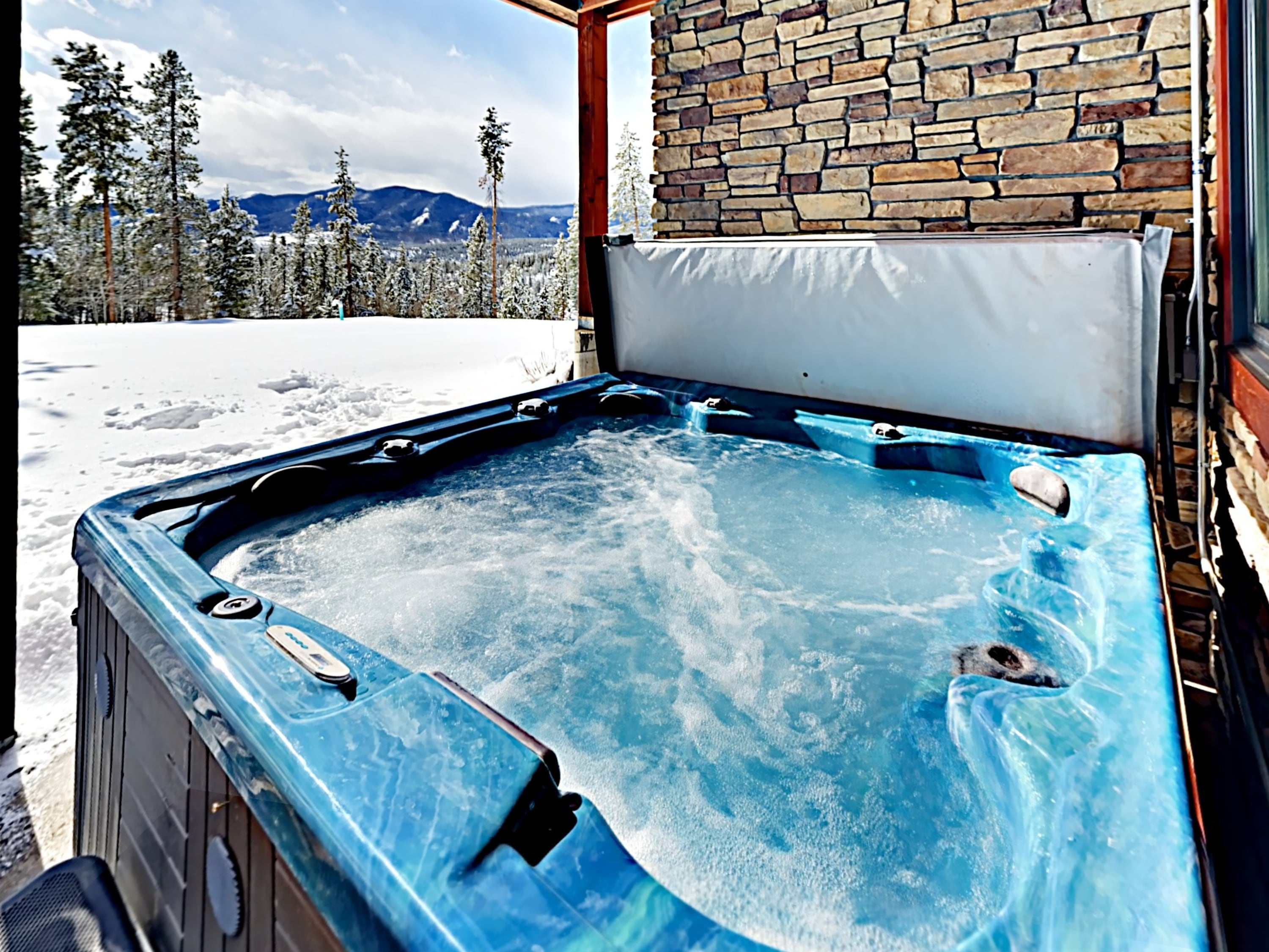Slide into the bubbling hot tub after a fun day of alpine adventure.