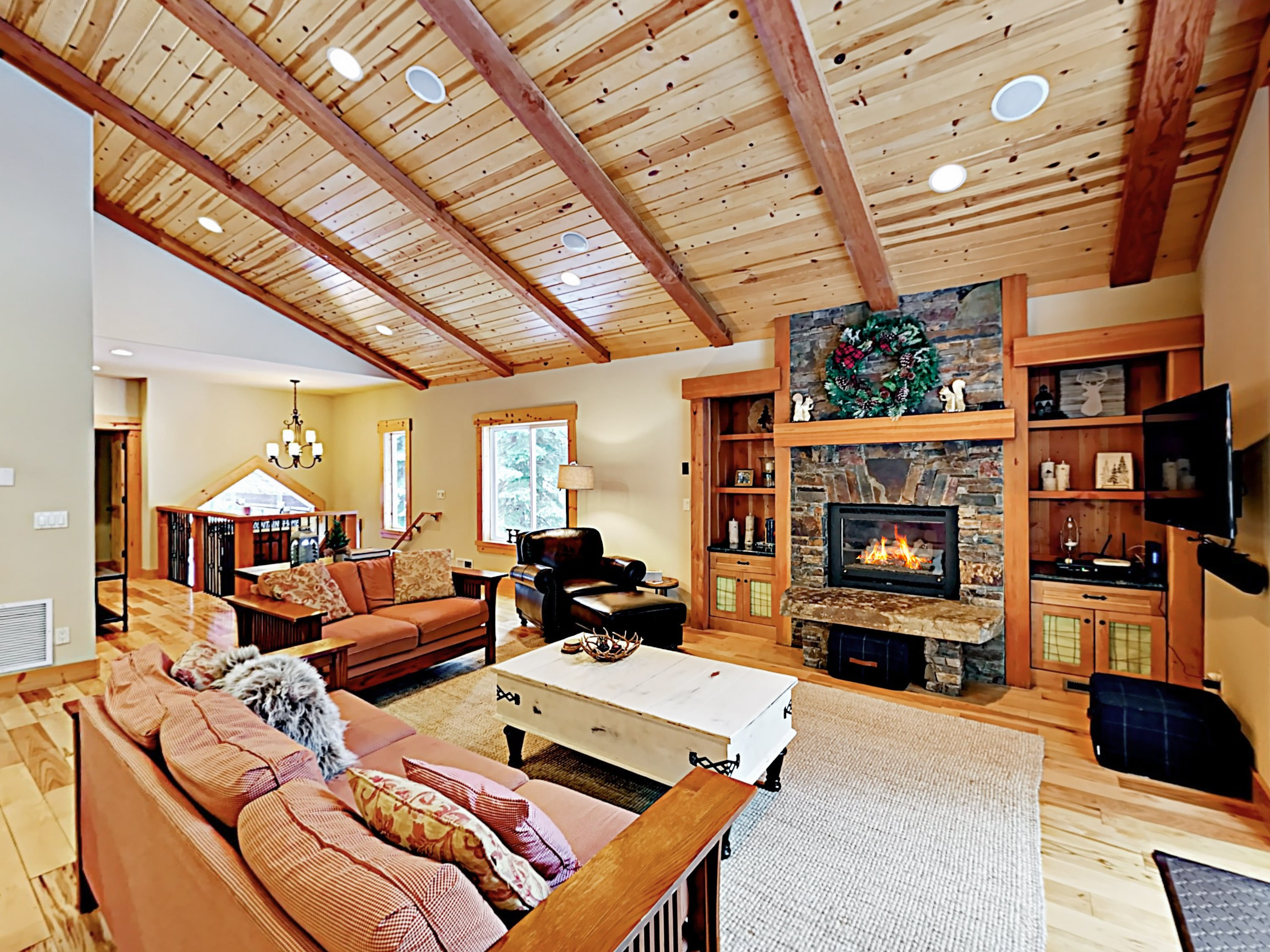 Welcome to Tahoma! This home is professionally managed by TurnKey Vacation Rentals. Warm wood ceilings soar in the airy living room, where there's seating for 7.
