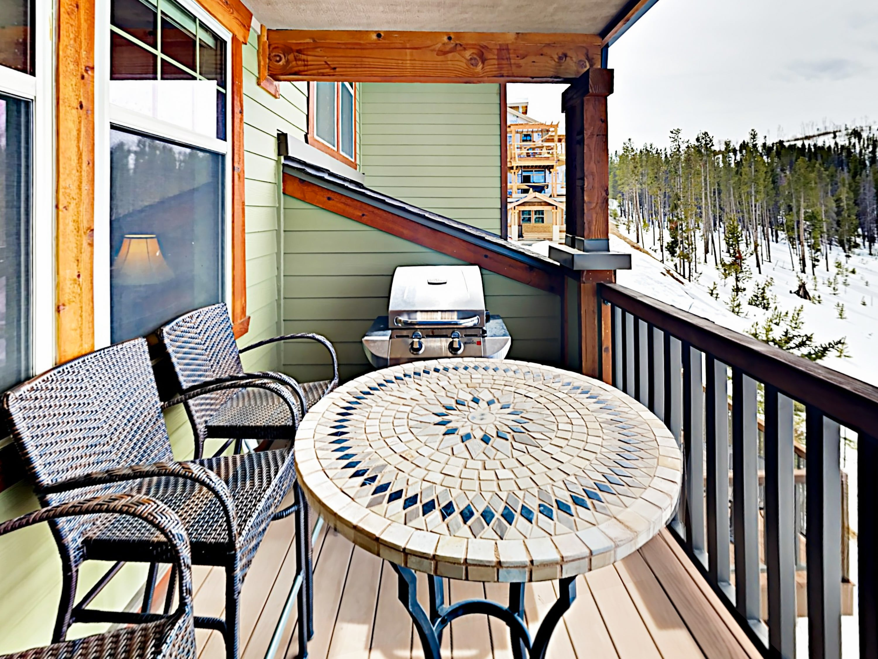 Sip morning coffee on the rear deck, furnished with a bistro table, grill, and seating for 4.