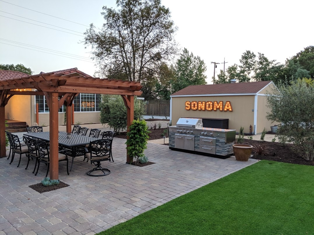 Outdoor extras include a tranquil fountain, wine barrel art installation, and a light-up Sonoma marquee sign.