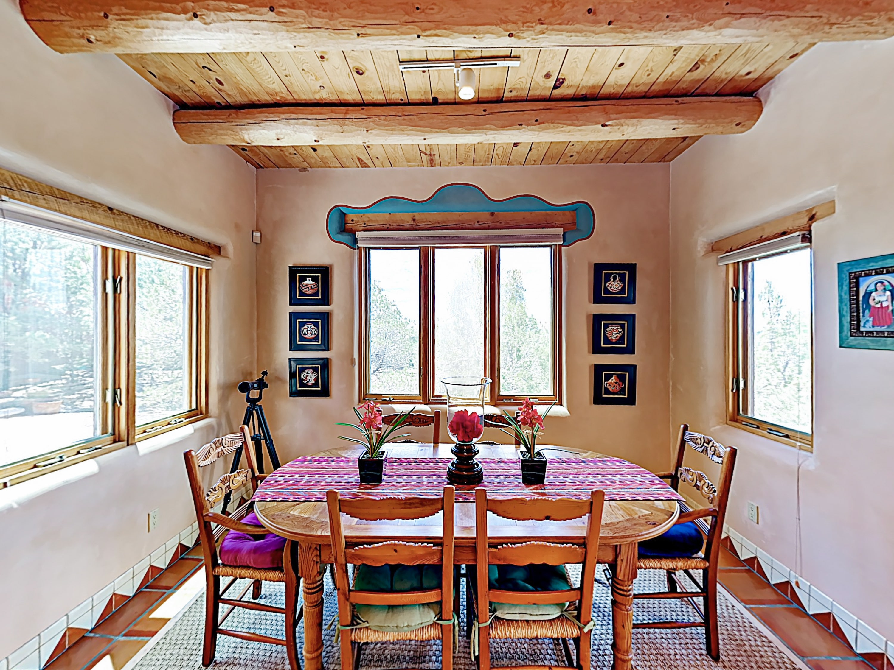 The window-lined dining area seats 6 to home-cooked meals.