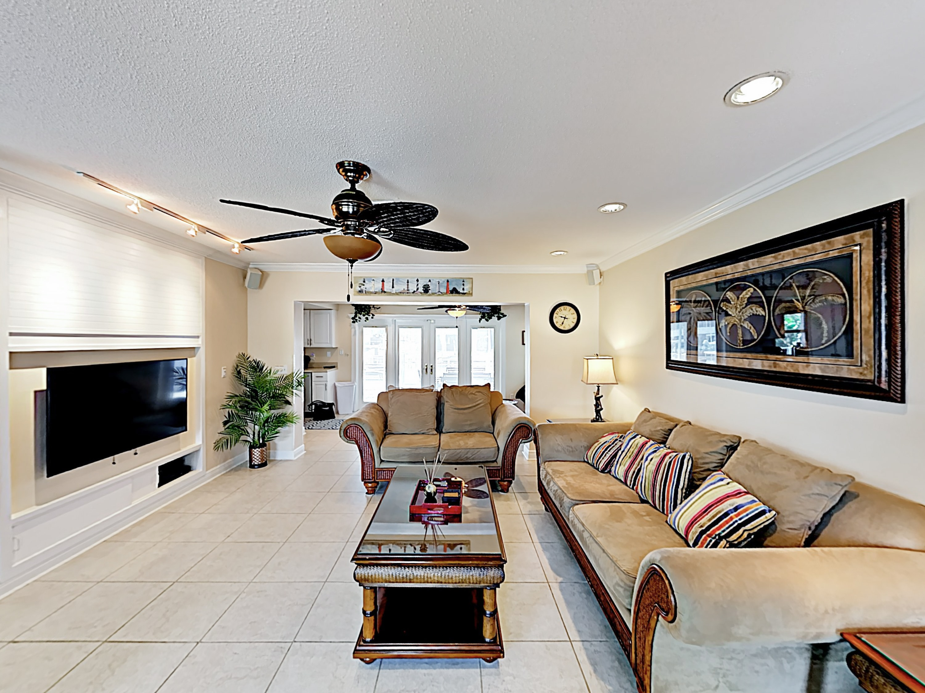 The living area is furnished with ample comfortable seating.