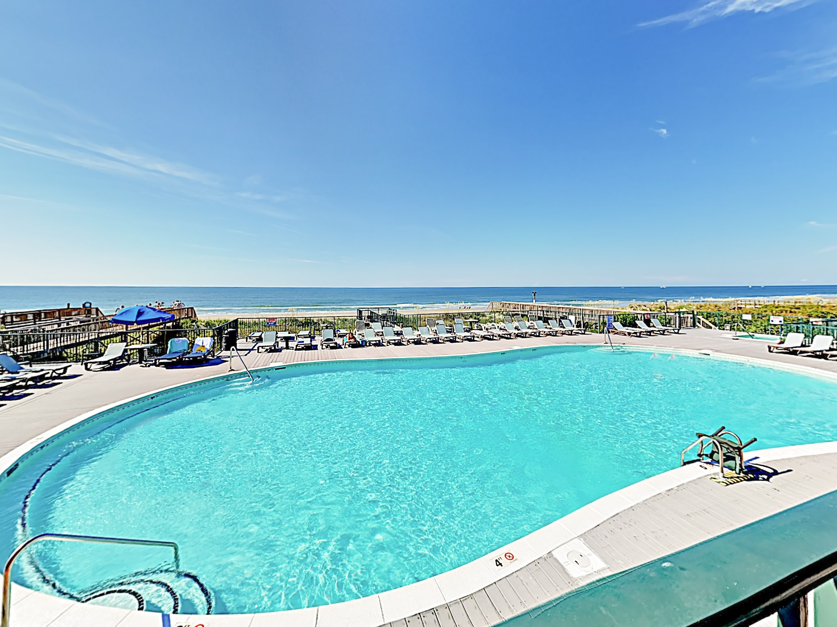 Swim in an expansive resort-style oceanfront pool.