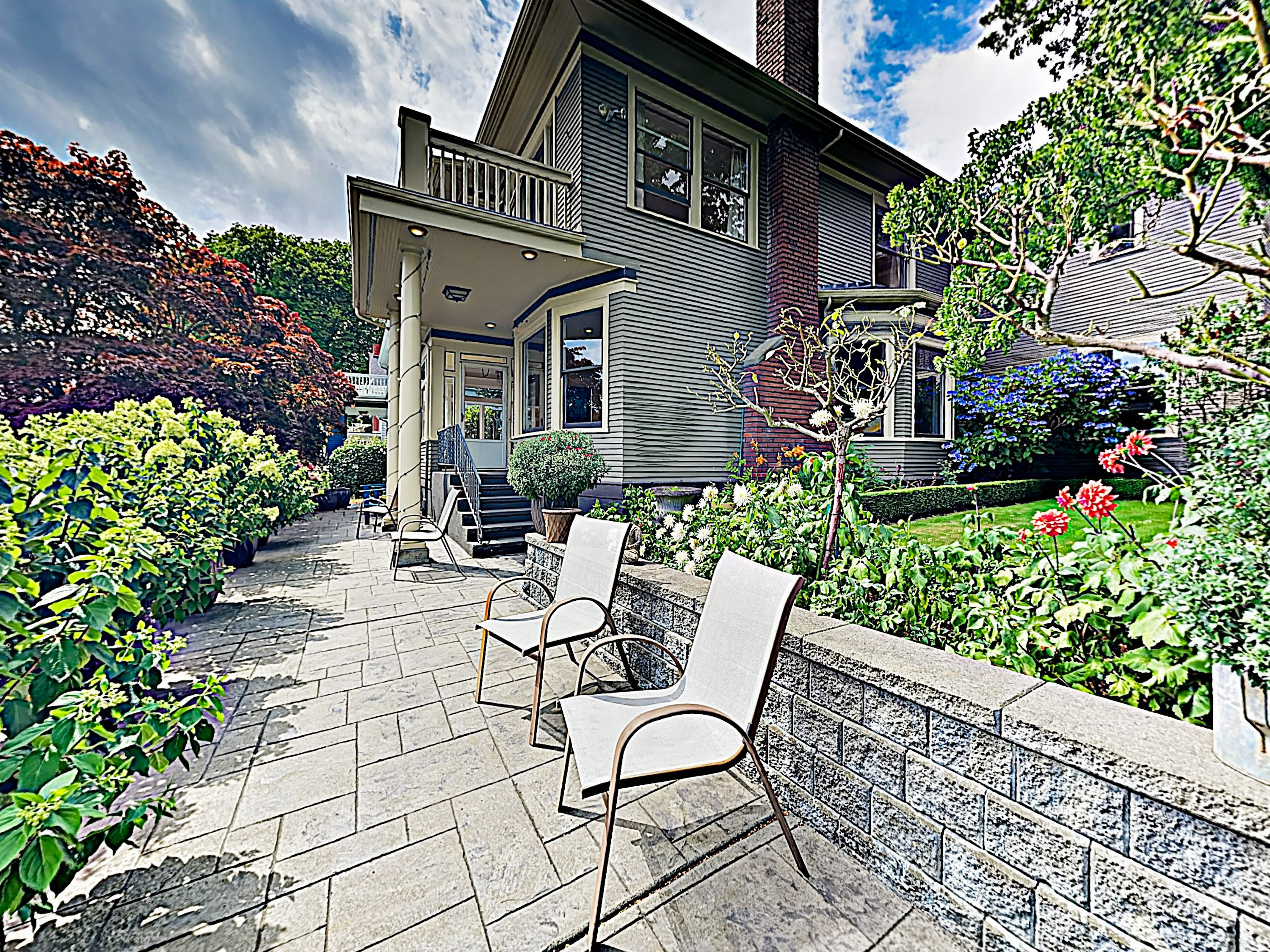 Soak up the sun among the flowers. The beautiful front yard offers a haven of relaxation.