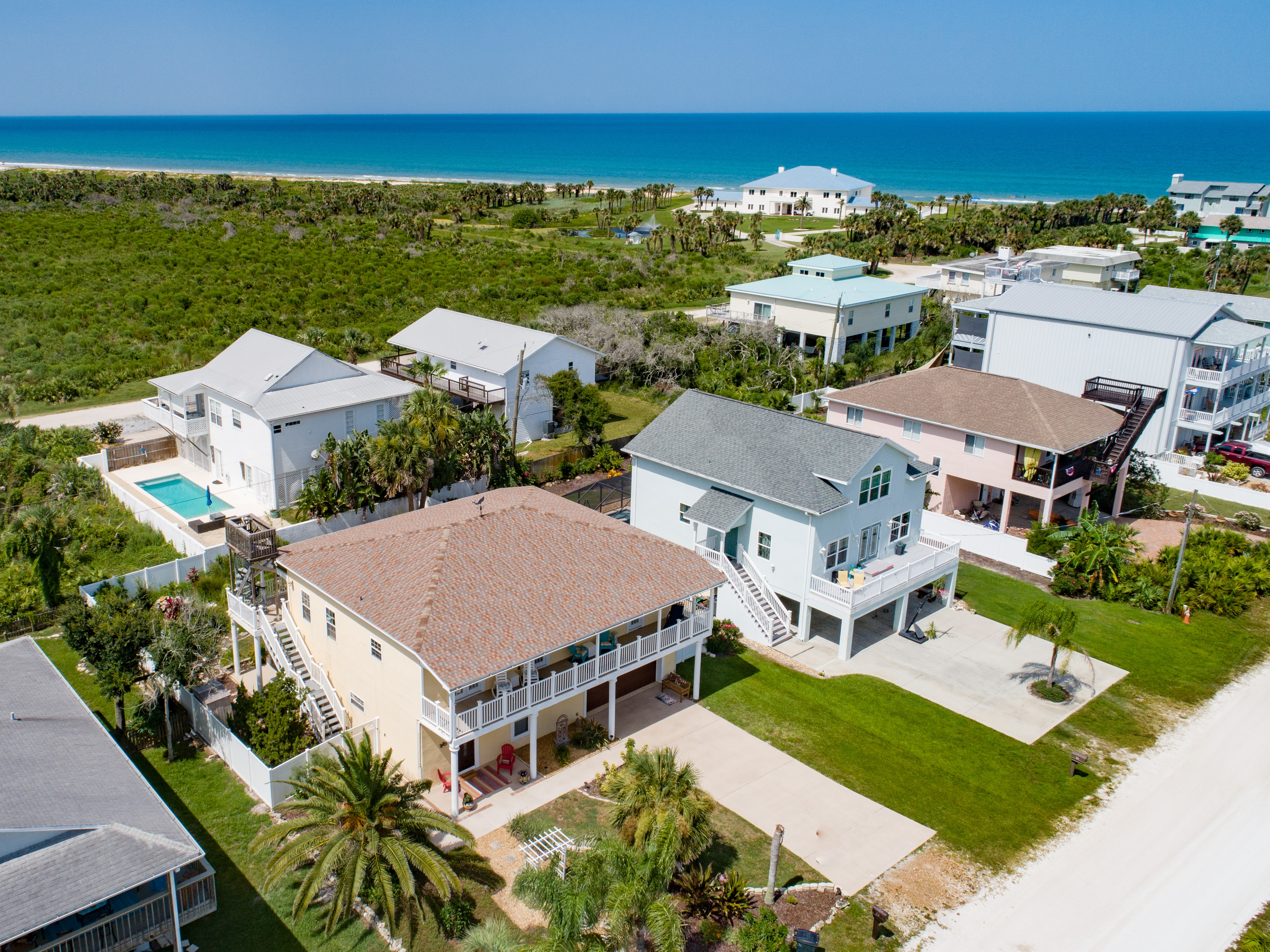 An aerial view of the home steps from the beach.