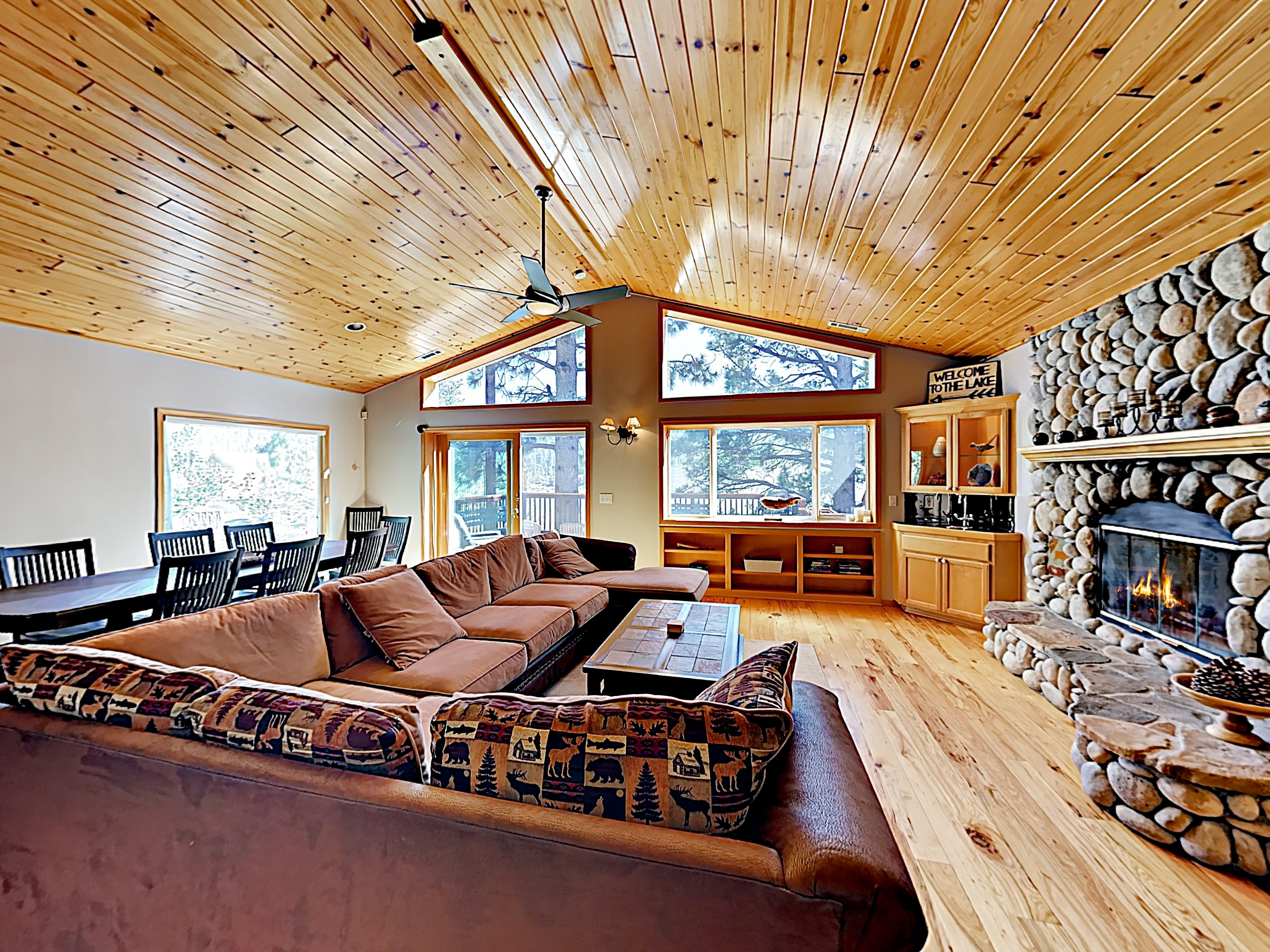 Welcome to Big Bear! Sunlight fills the Great Room, setting off glossy pecan floors and vaulted ceilings.