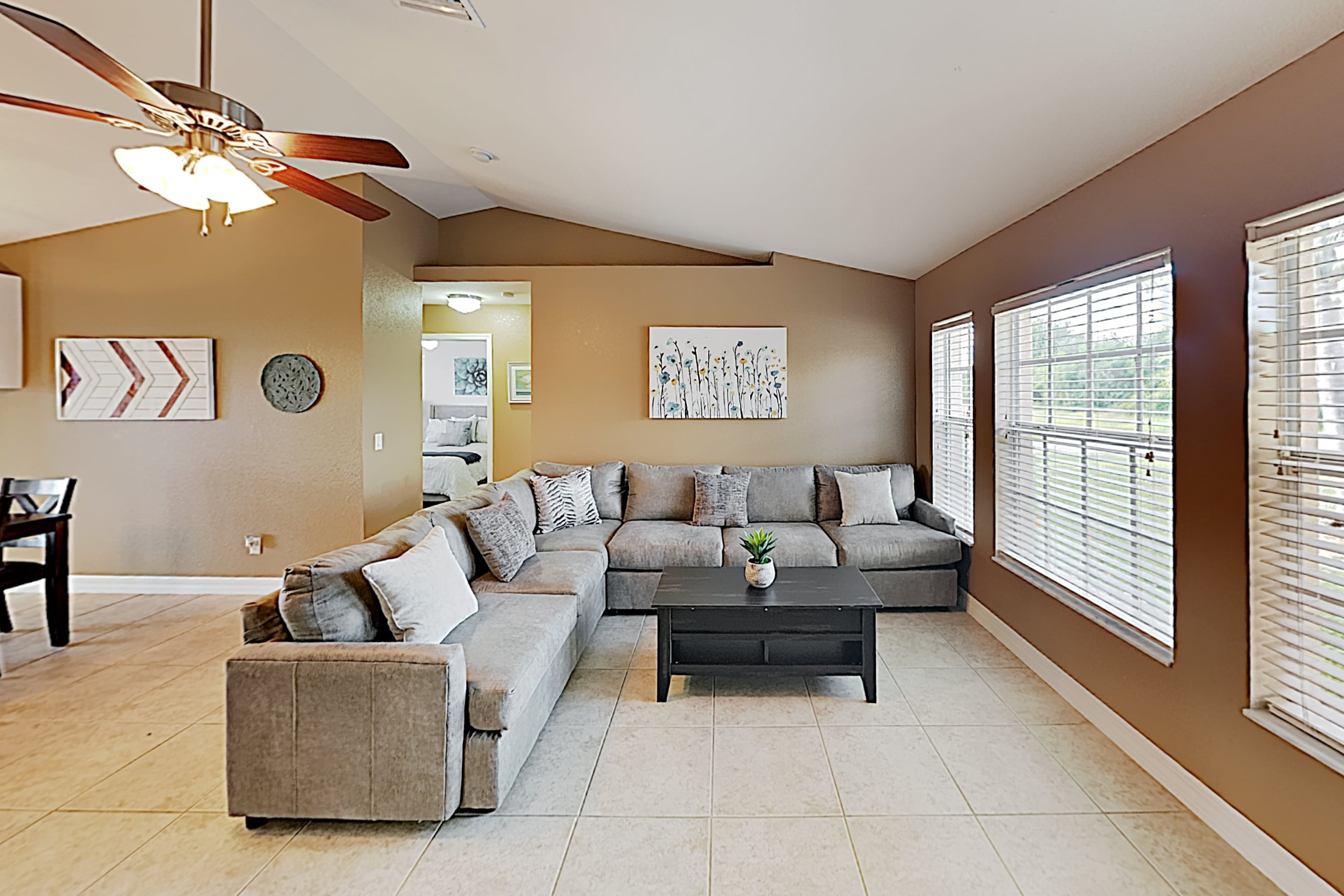 Relax on a comfy sectional in the light-filled living area.