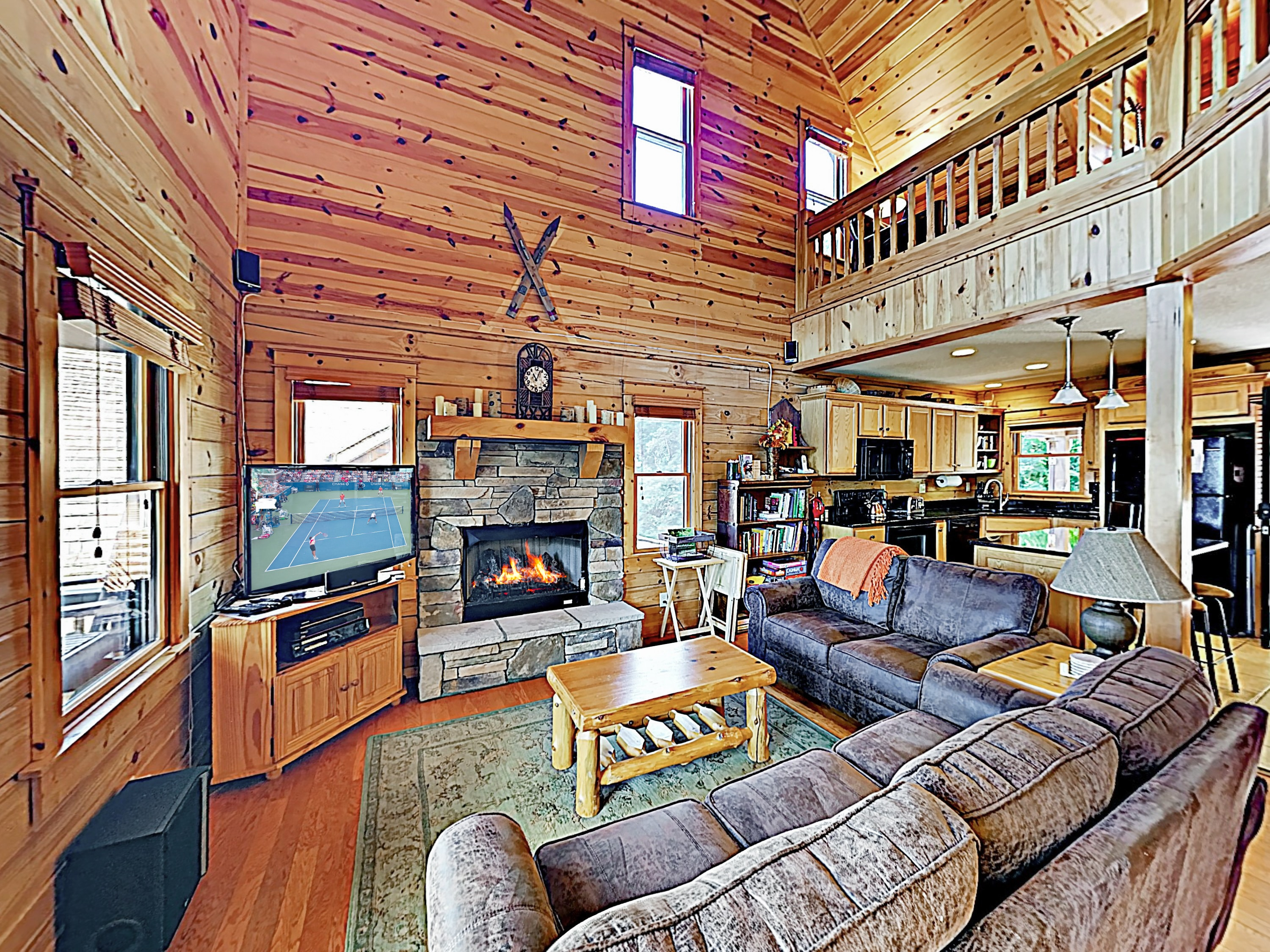 A gas fireplace and authentic mountain decor create a warm, lodge-like ambience in the living area.