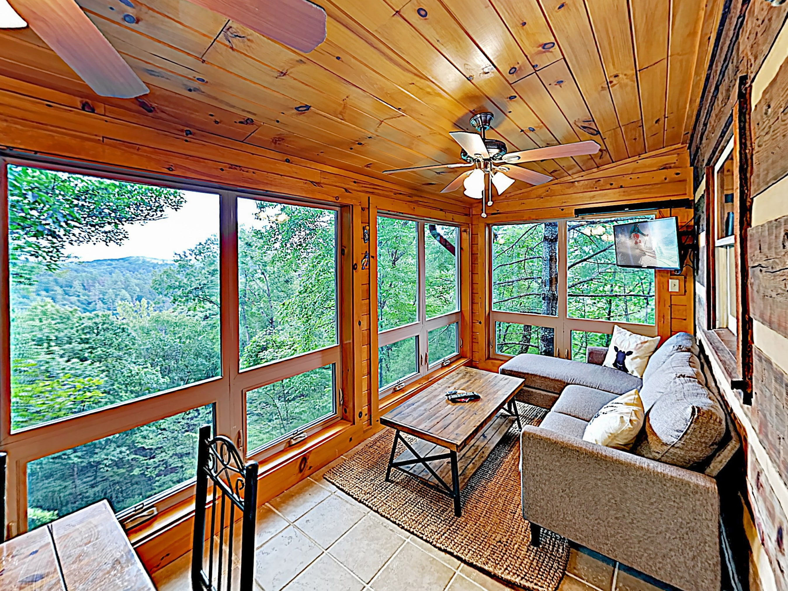 Take in sweeping views of rolling greenery from the ground-floor sunroom.