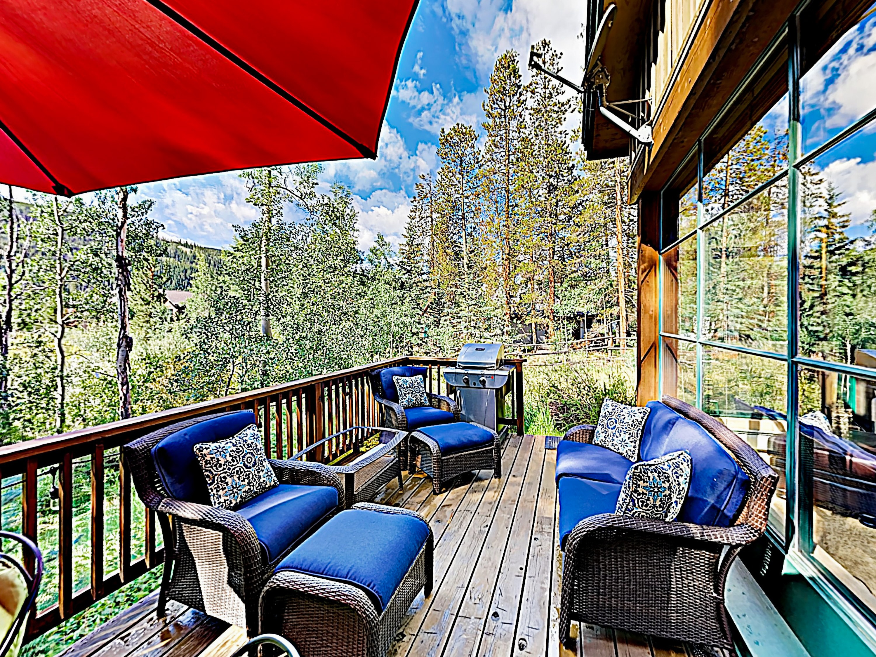 Your private deck offers a sunny-day haven with  cushioned outdoor furniture.
