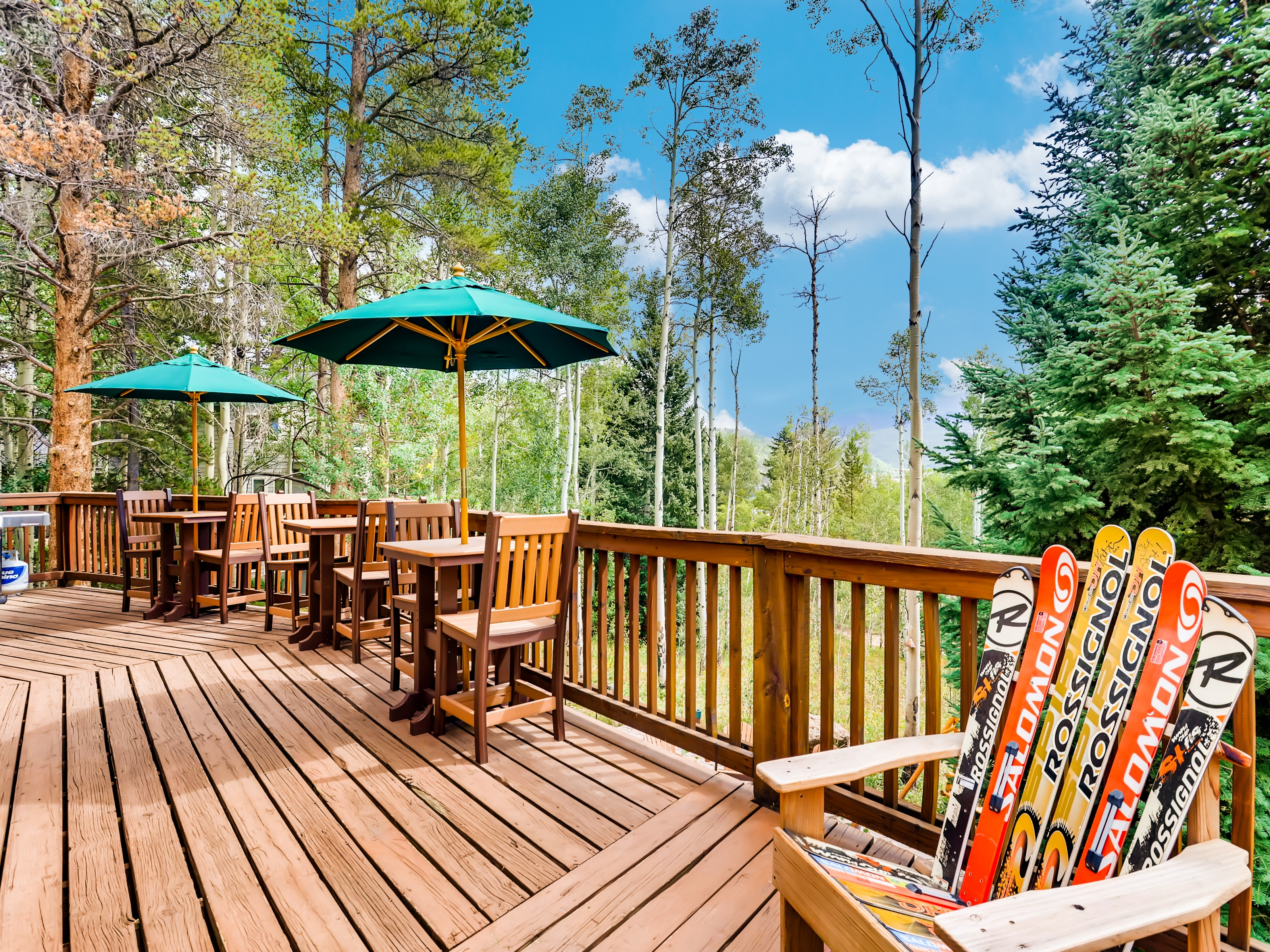 There's ample seating for alfresco meals and relaxing in the sun on the wraparound deck.