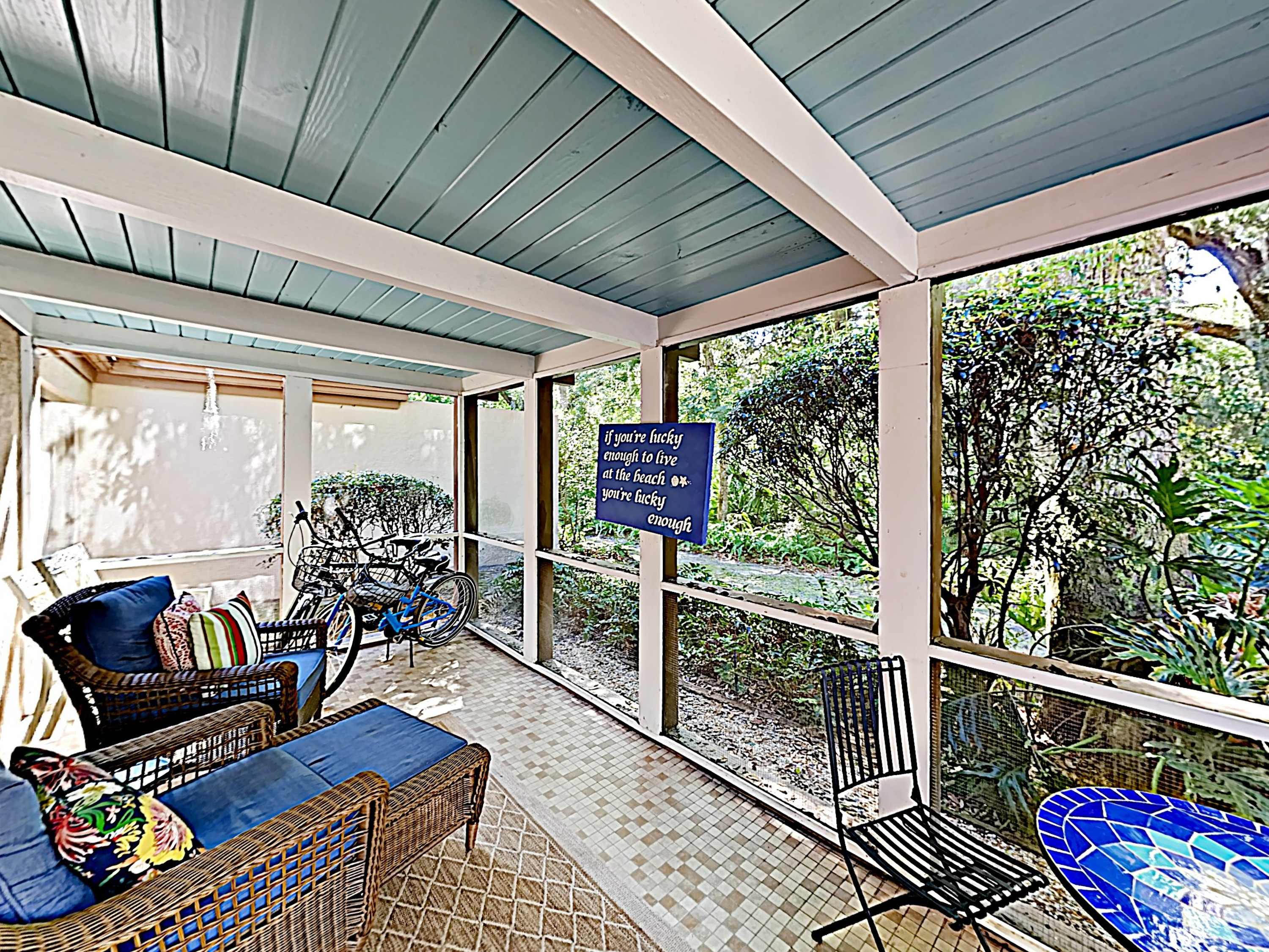 Lush foligage surrounds your private lanai - a lovely spot for morning coffee.