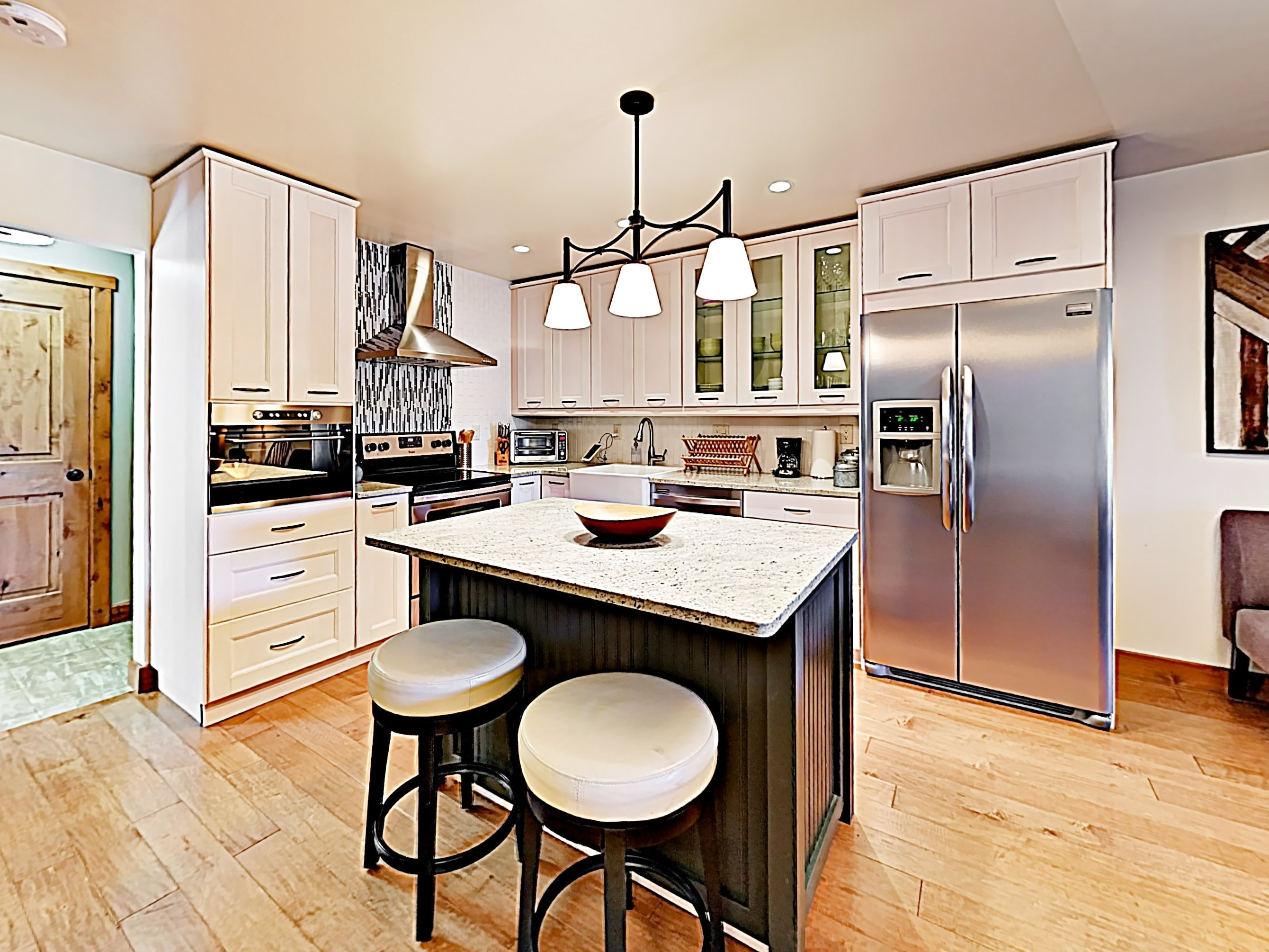 Chefs will appreciate modern kitchen, newly updated with stainless steel appliances.