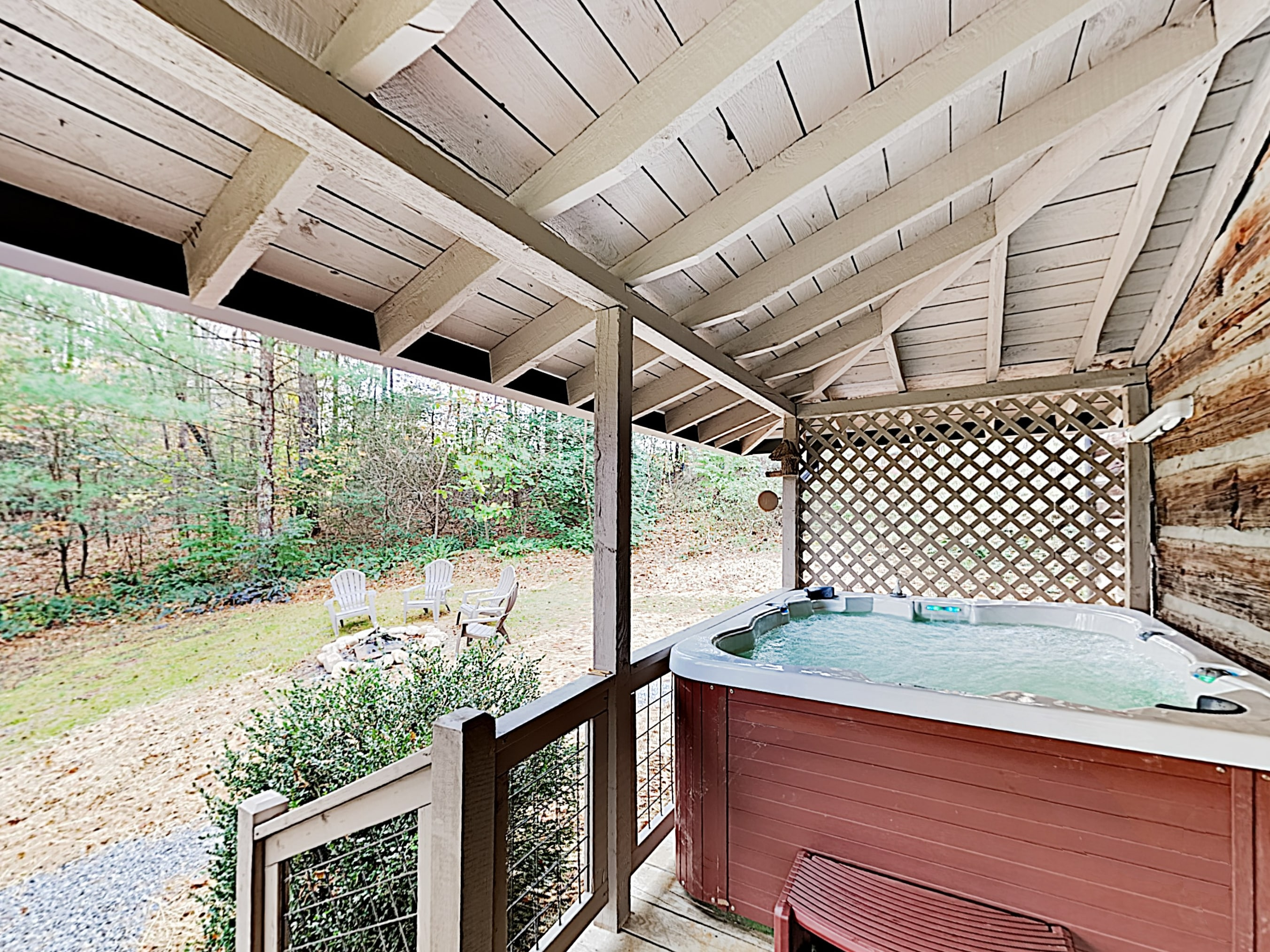 Soak in the private hot tub on the covered deck.