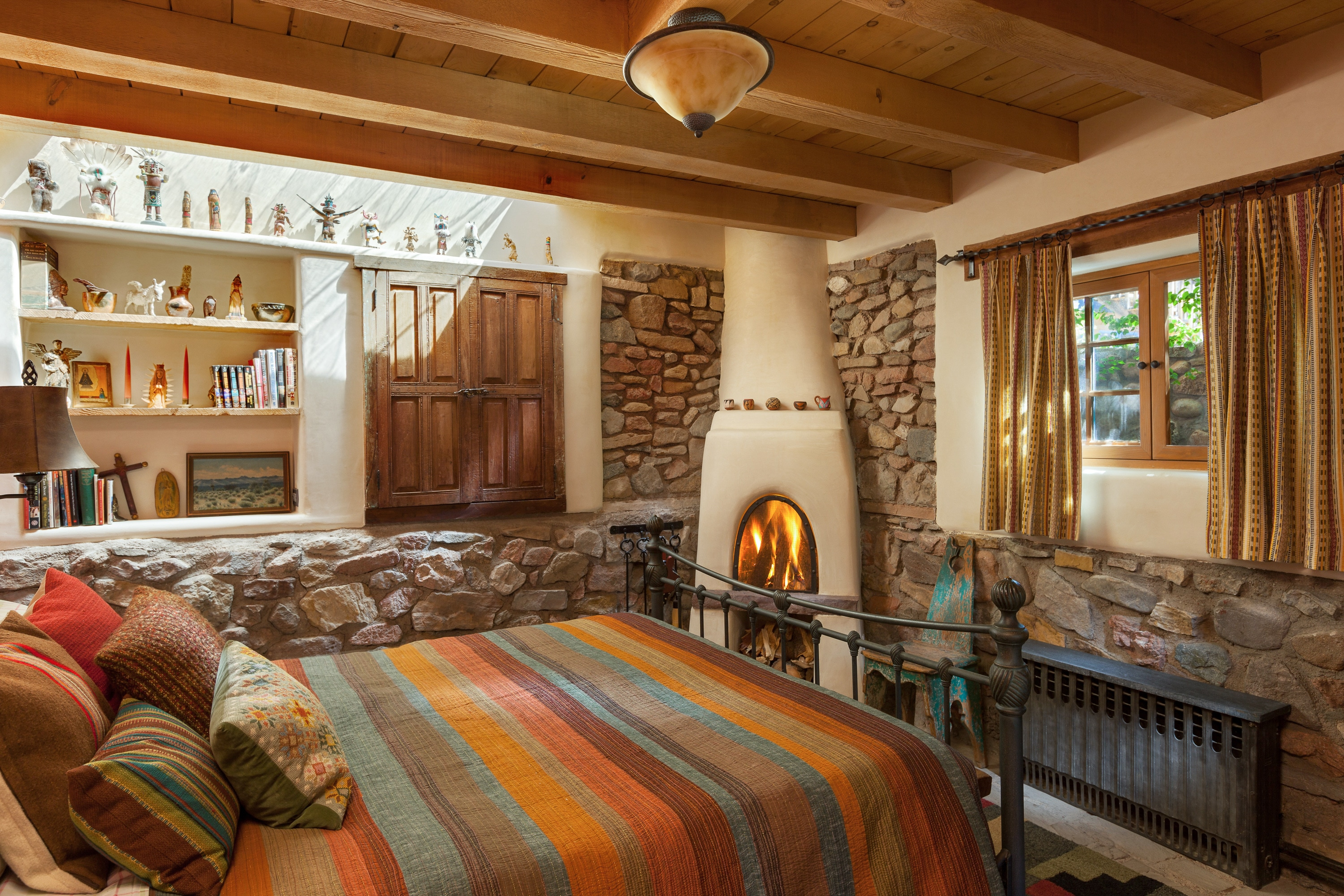 Both bedrooms have wood-burning fireplaces.