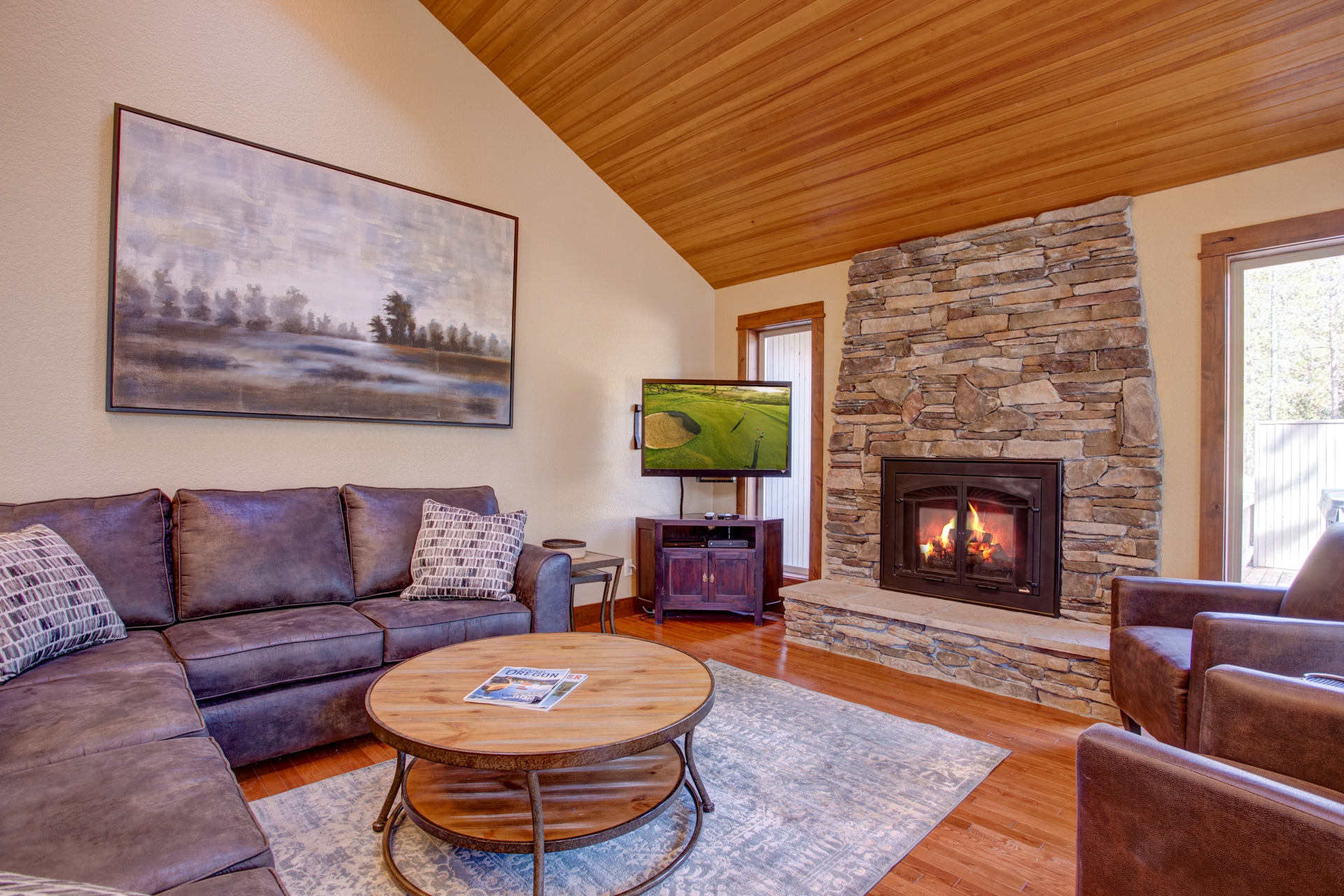 "Gather around the gas fireplace and the 42"" flat-screen TV in the living room."