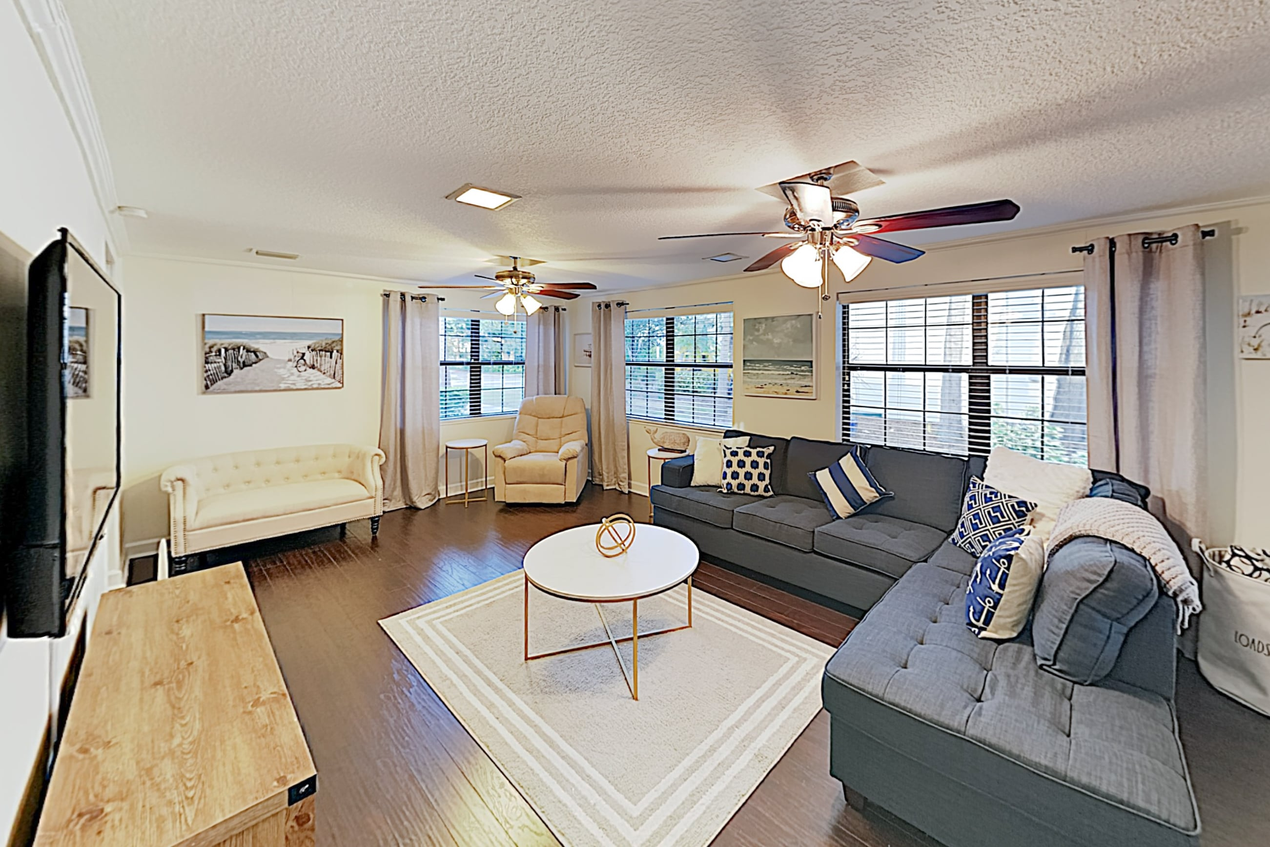 "Welcome to Tampa! The living room is furnished with a queen-size sleeper sectional and a 54"" smart TV."