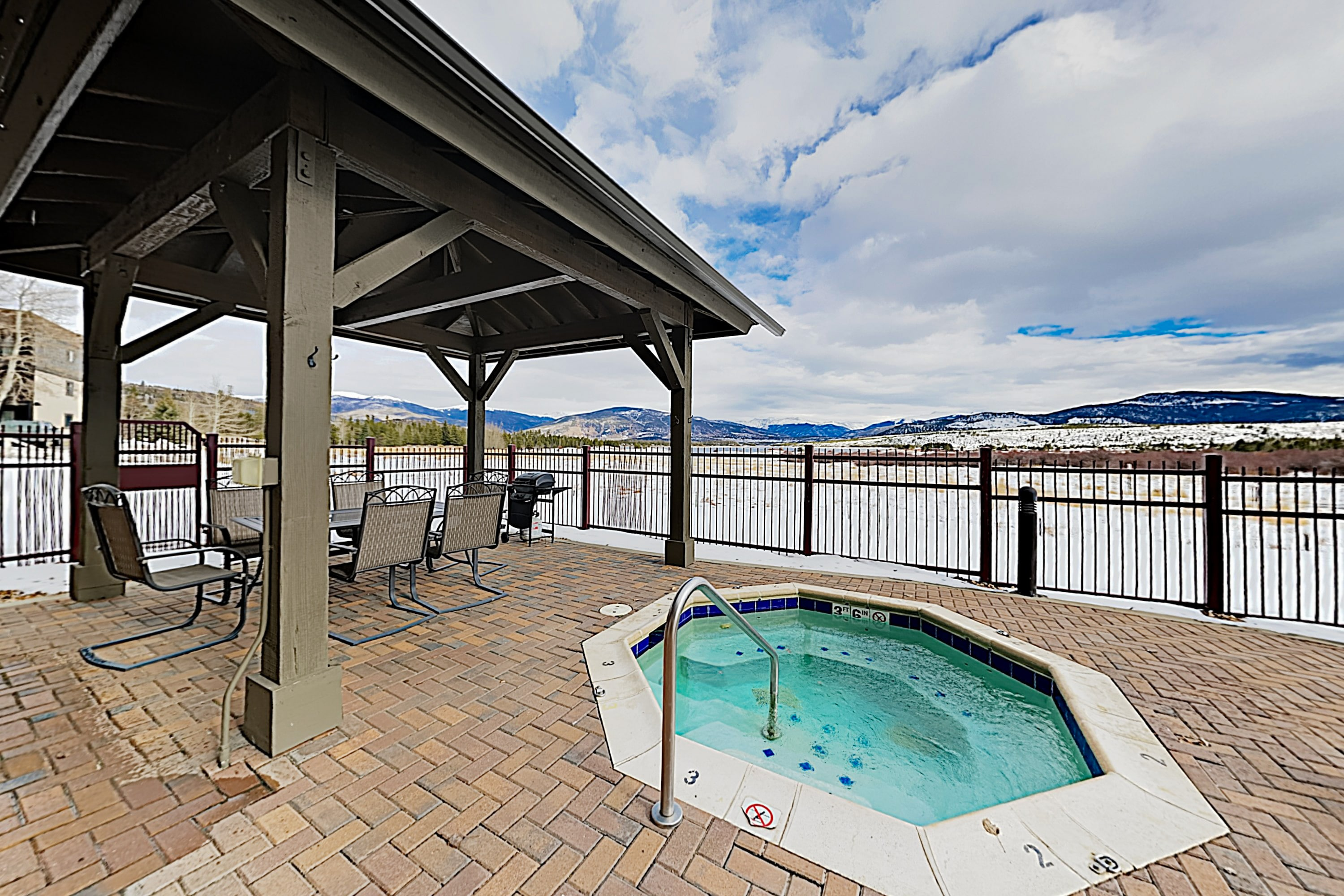 Relax in 2 shared hot tubs overlooking the lake.