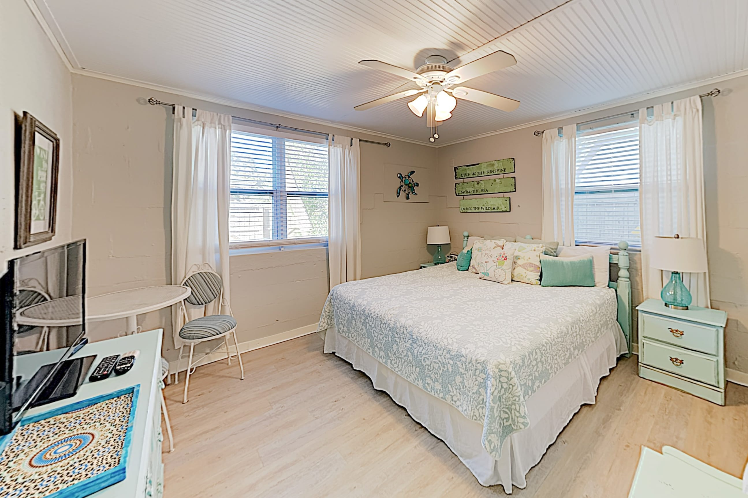 Find quiet privacy in the master bedroom, furnished with a king bed.
