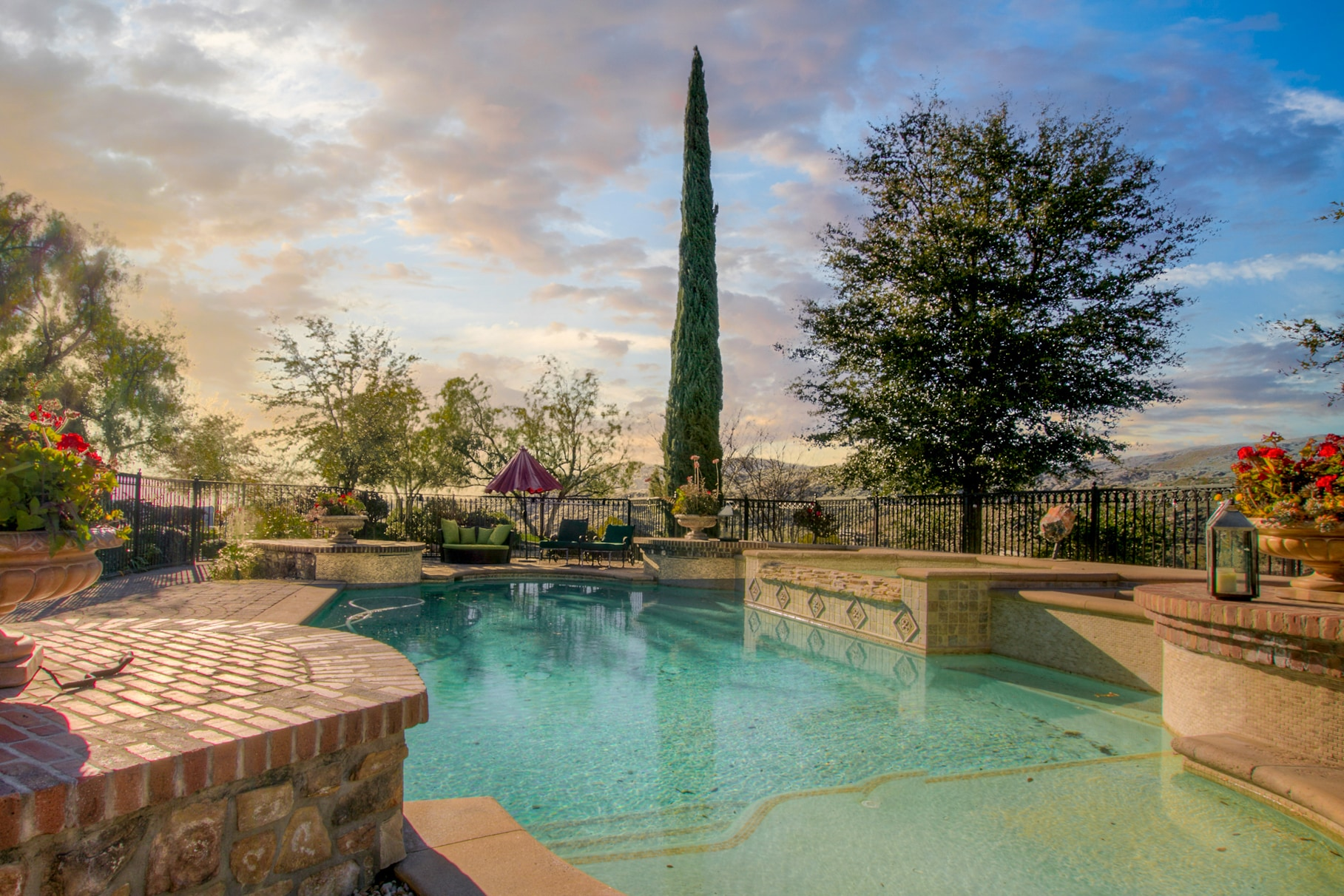 The custom pool and spa provide a stunning outdoor sanctuary.
