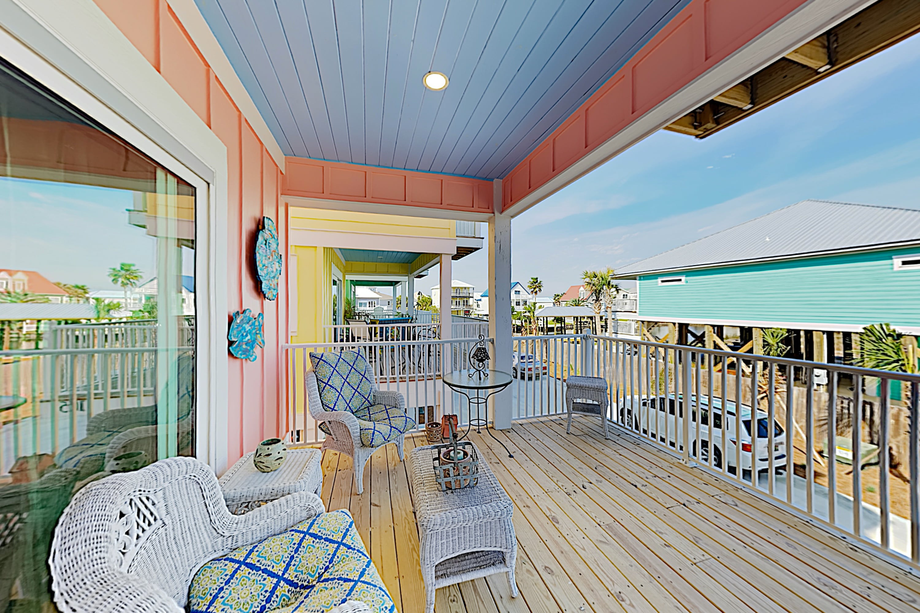 Take in the coastal breeze on the covered deck.