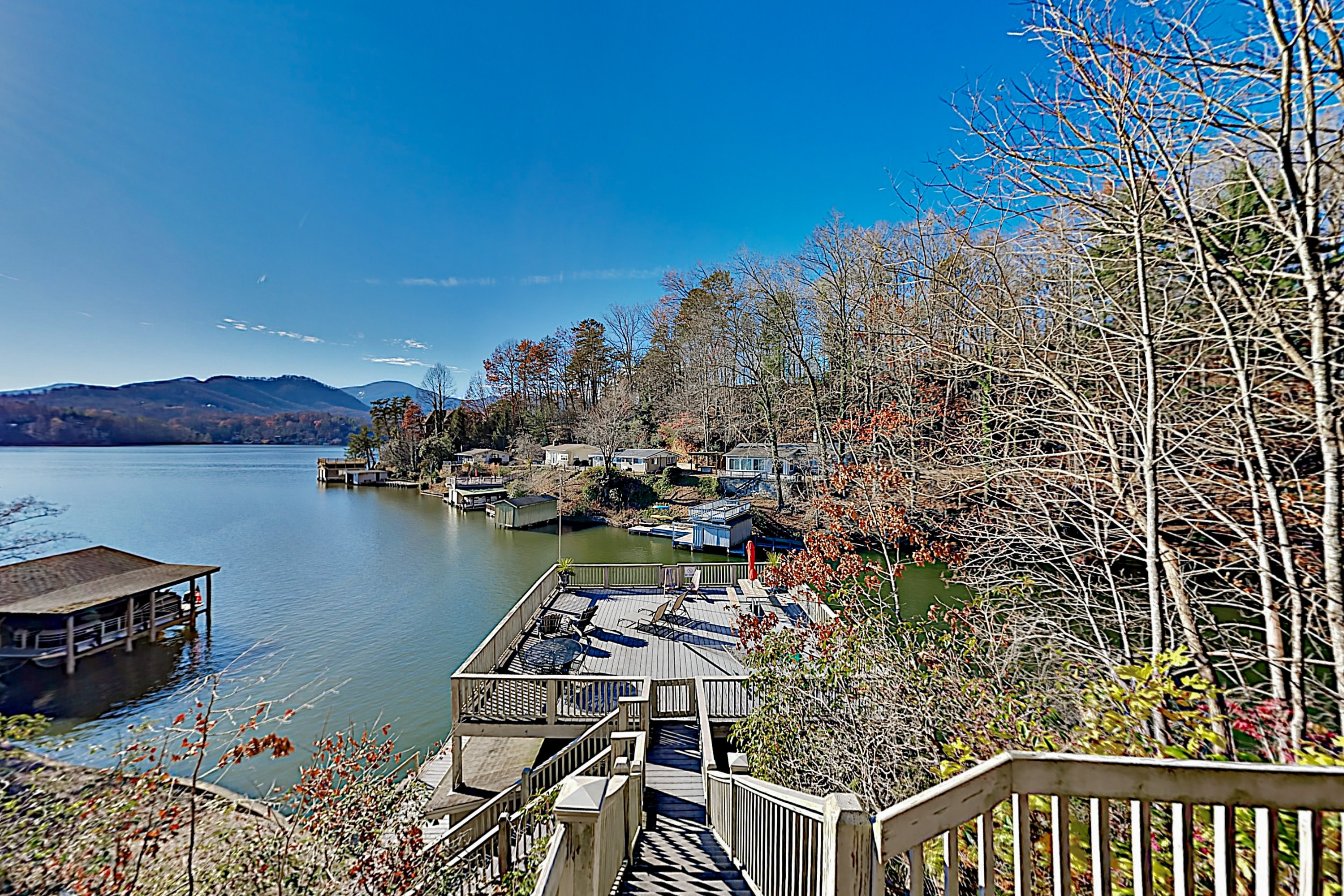 Property Image 1 - Lakefront Home with Private Dock & Mountain Views