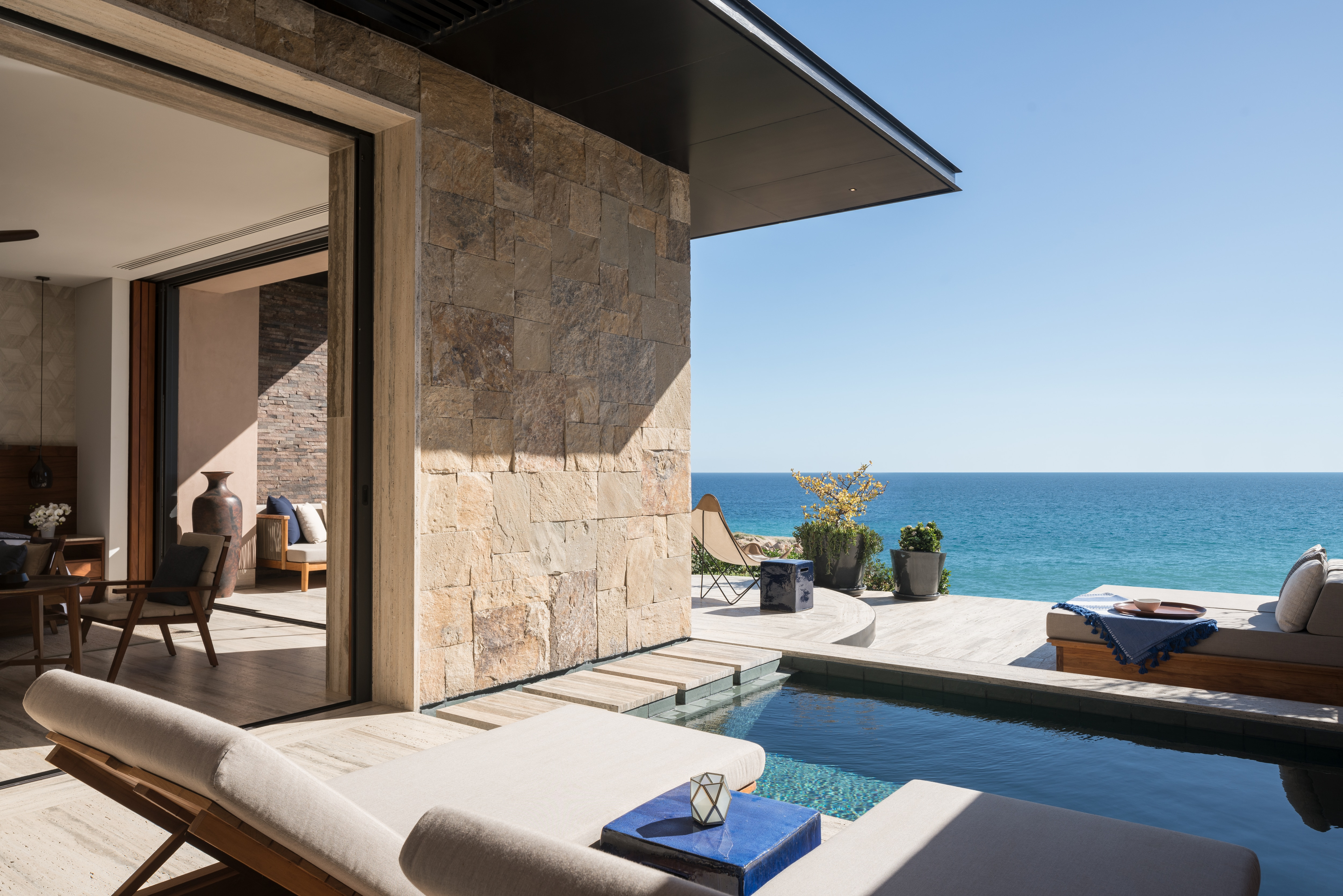 Inviting pool with sun loungers and sea view