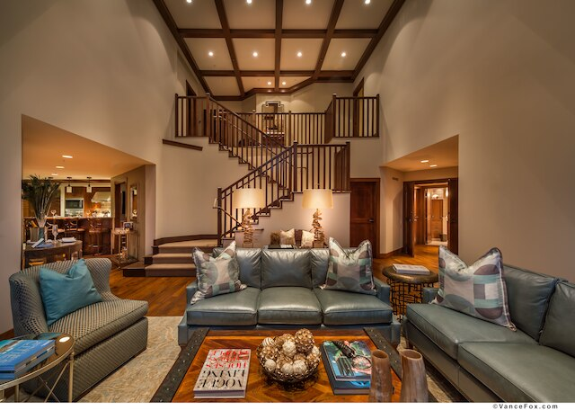 Large living room and staircase to upper level