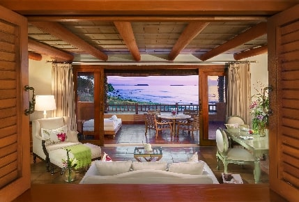 Suite living area and balcony at sunset