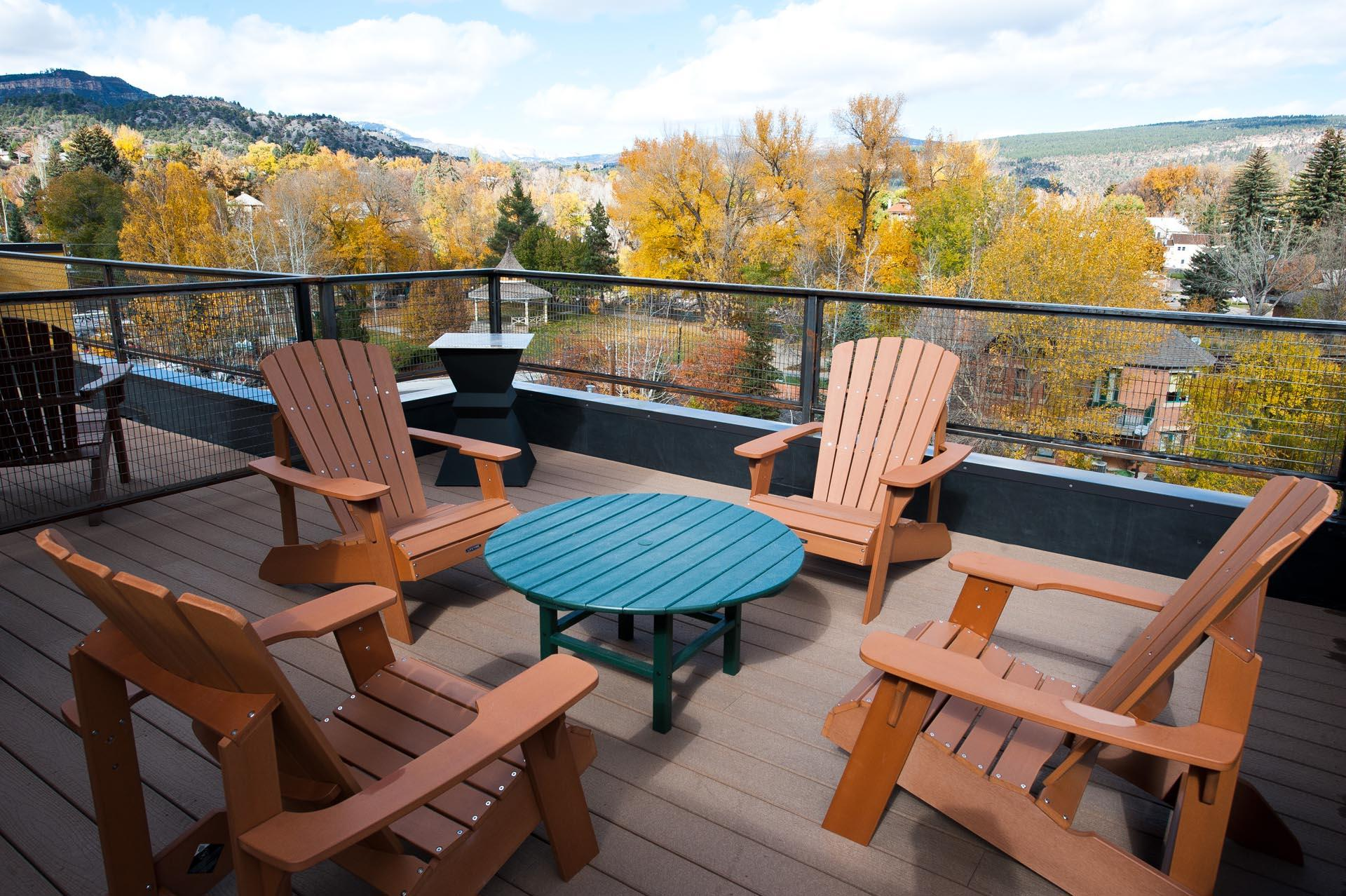 Rooftop patio with outdoor seating area. Gorgeous views of the mountains, train bridge, and Animas River