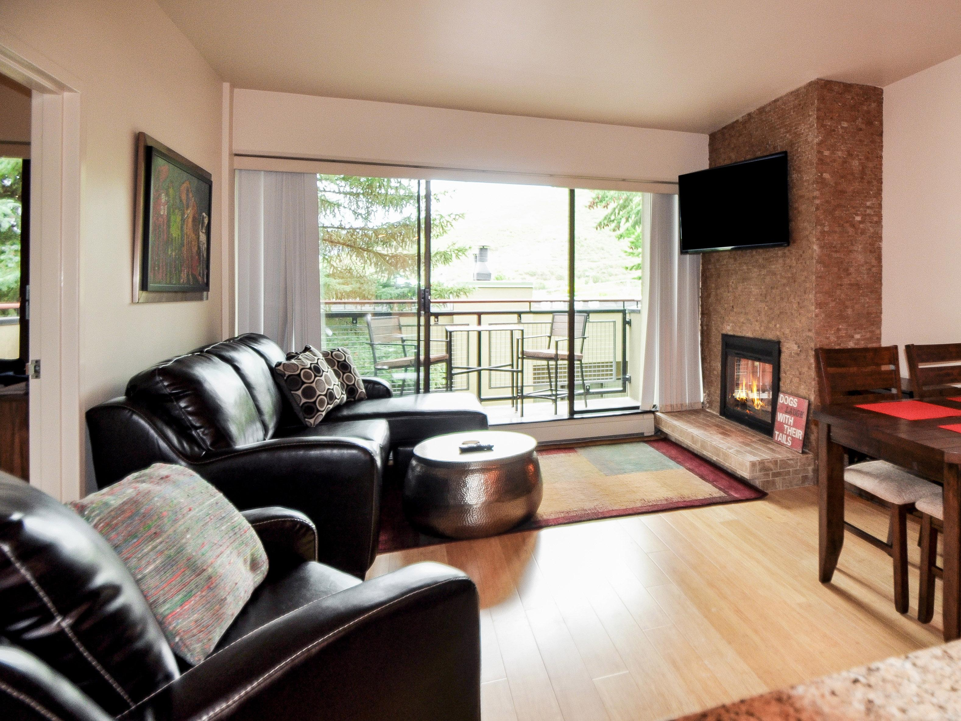 A cozy space with gas fireplace and gorgeous view.