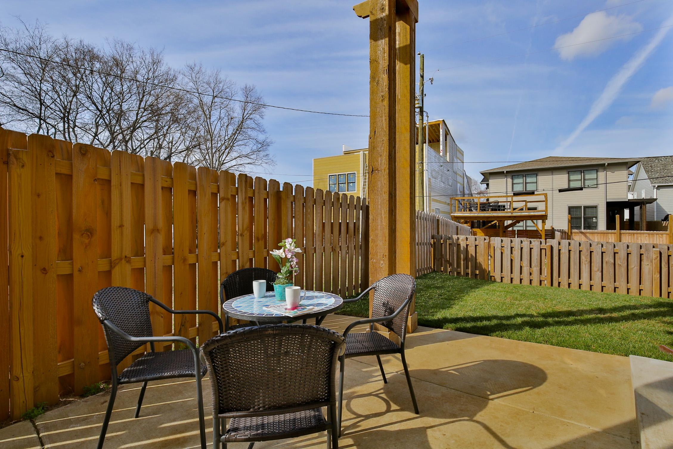 The spacious backyard is perfect for enjoying your morning coffee or evening bottle of wine.