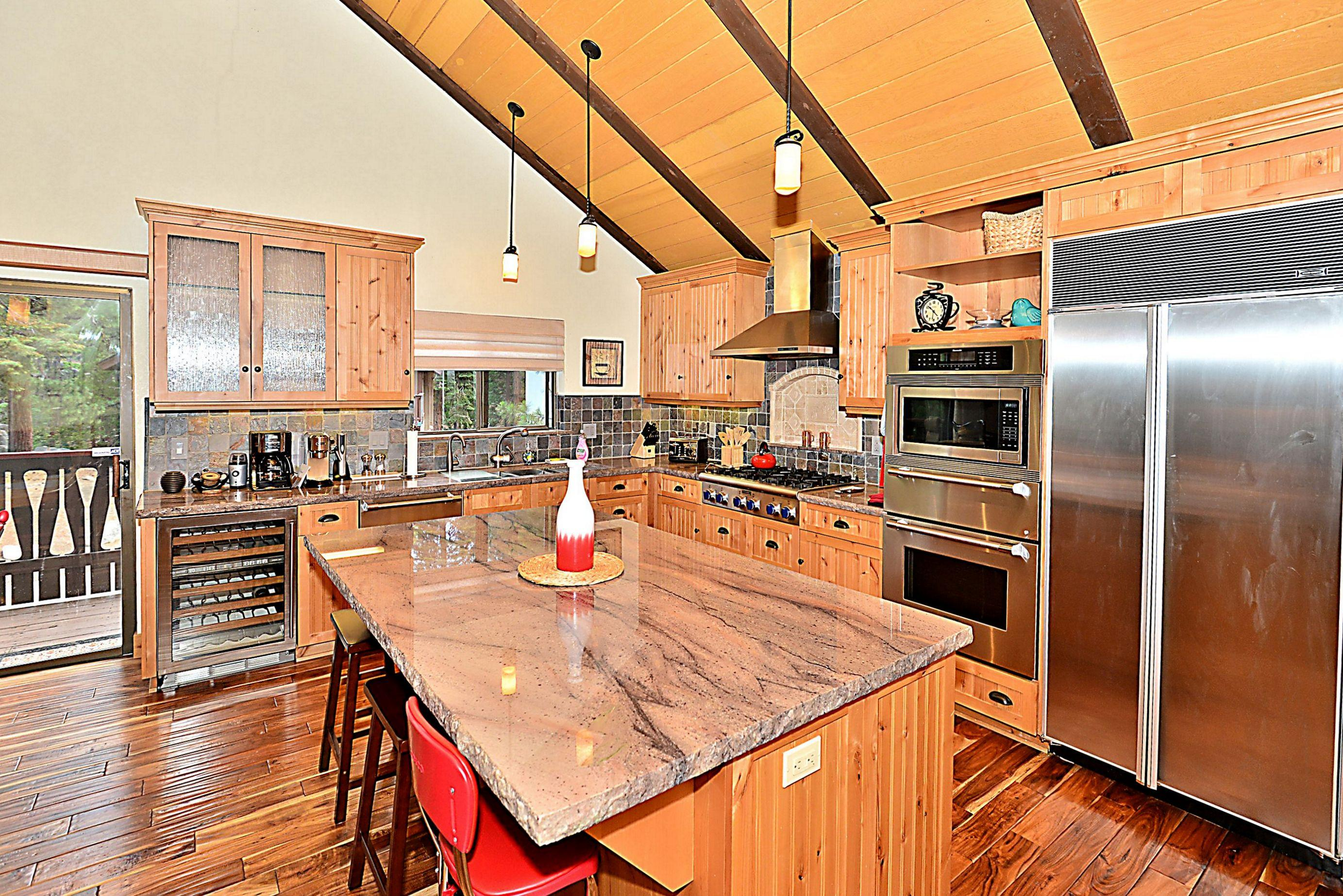 The kitchen is newly remodeled with top-of-the-line chef's appliances and a granite island.