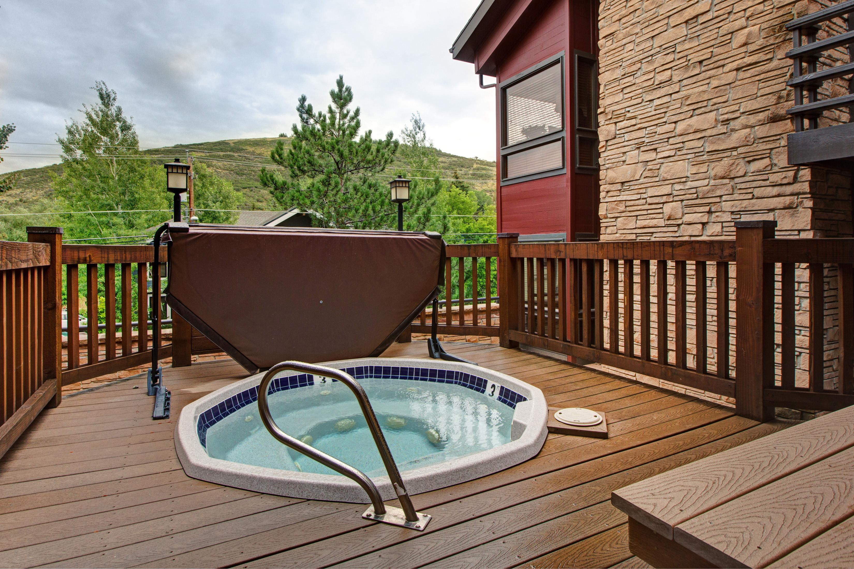 Take in gorgeous tree-lined views while you soak in one of the 2 hot tubs on-site.