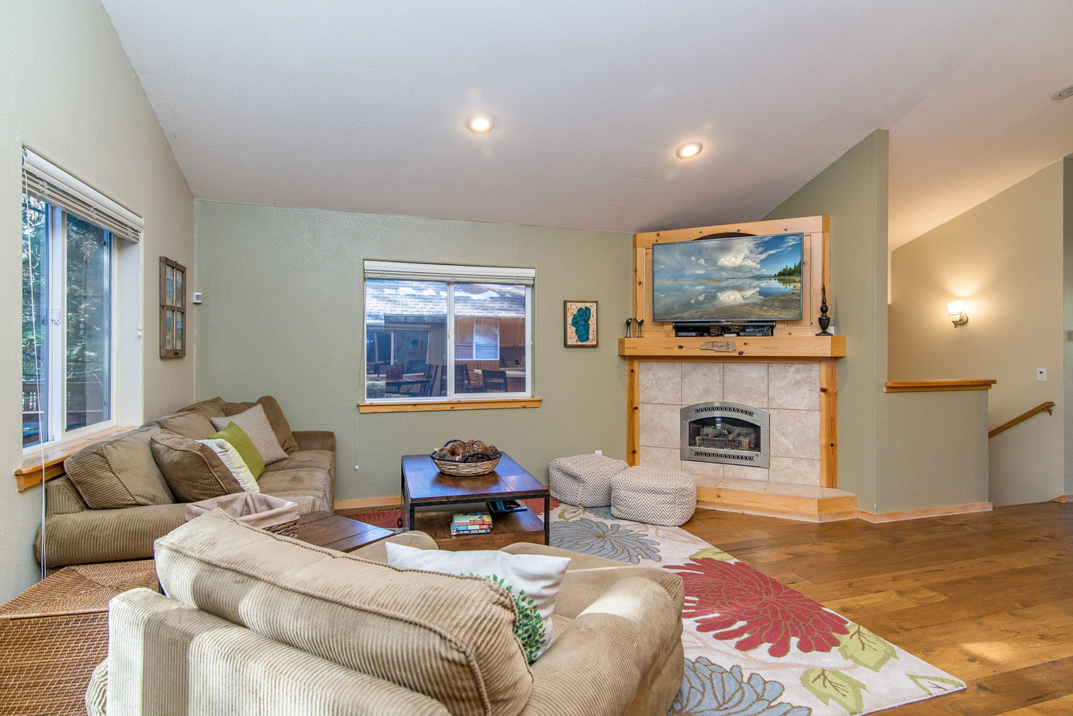 "Cozy up next to the gas fireplace and watch a movie on the 55"" TV in the living room."